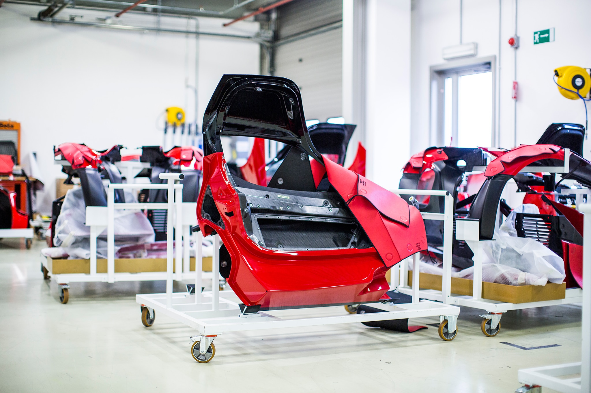 In a side room, various LaFerrari body pieces wait to be attached to a chassis.