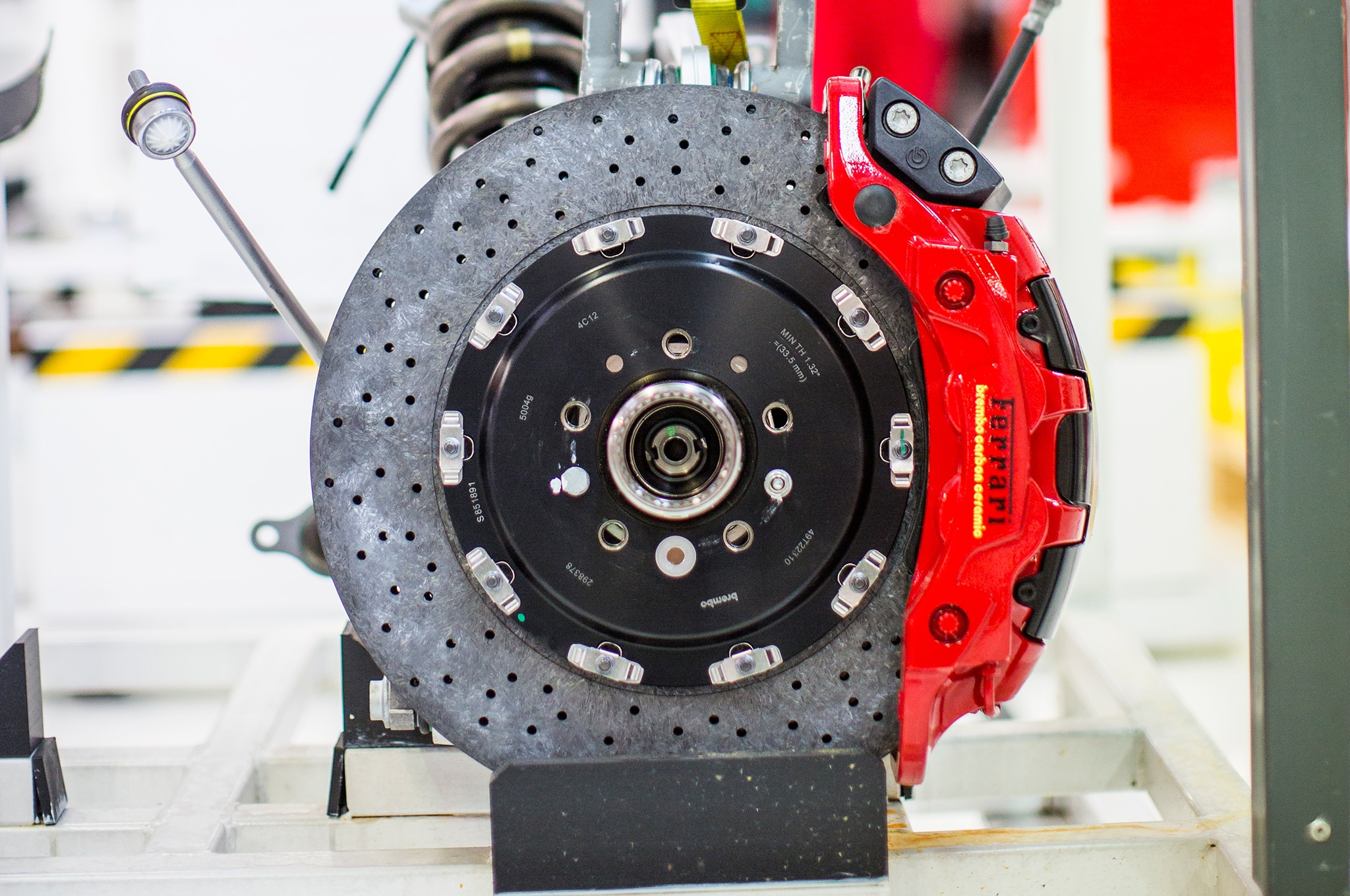 Giant carbon-ceramic brake rotors by Brembo are standard.