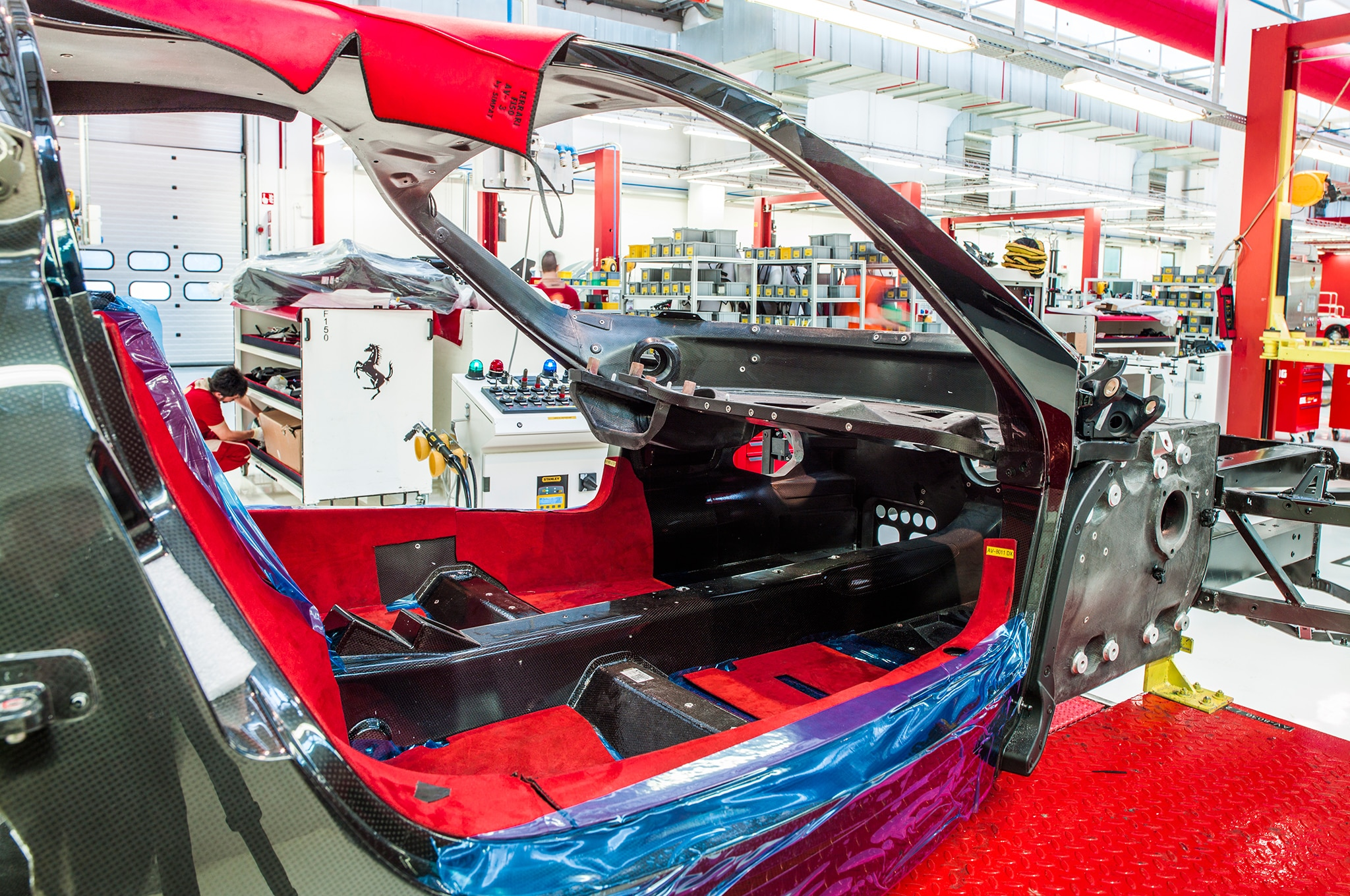 Red padding and blue plastic protect that chassis from nicks and dings through the production process.