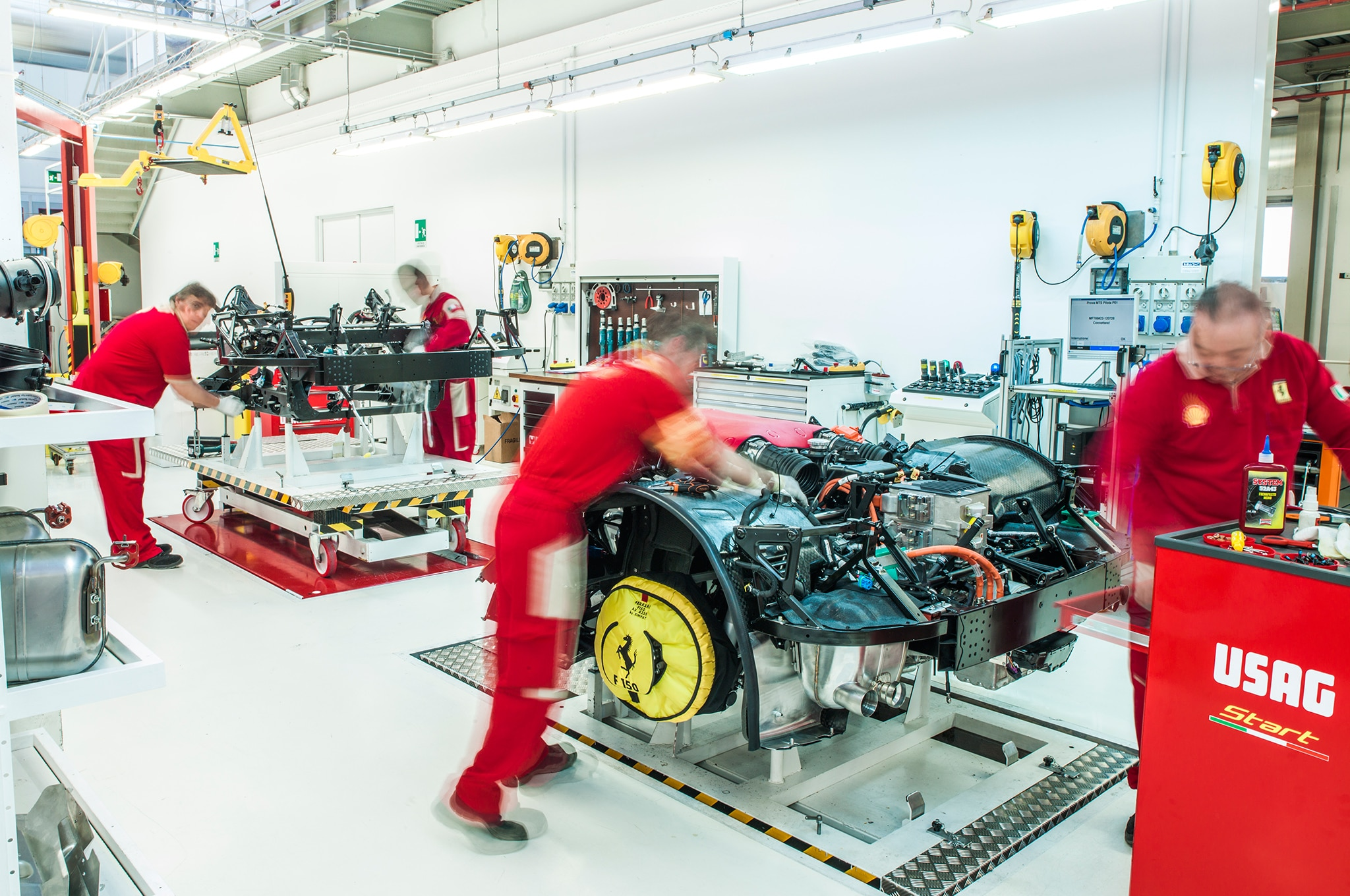Ferrari technicians at work on the V-12 hybrid powertrain.