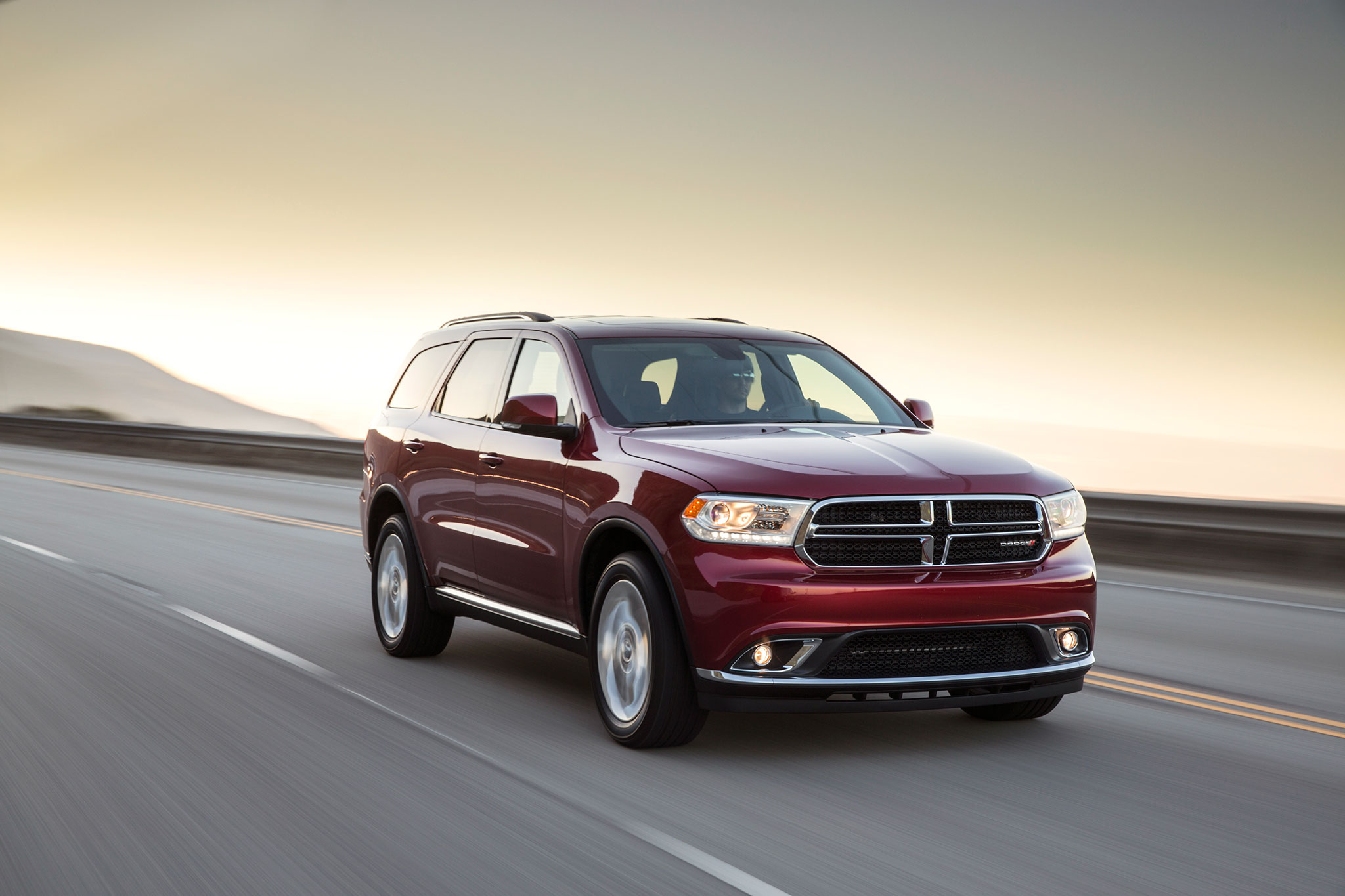 2014 Dodge Durango Limited Passengers Three Quarters In Motion1