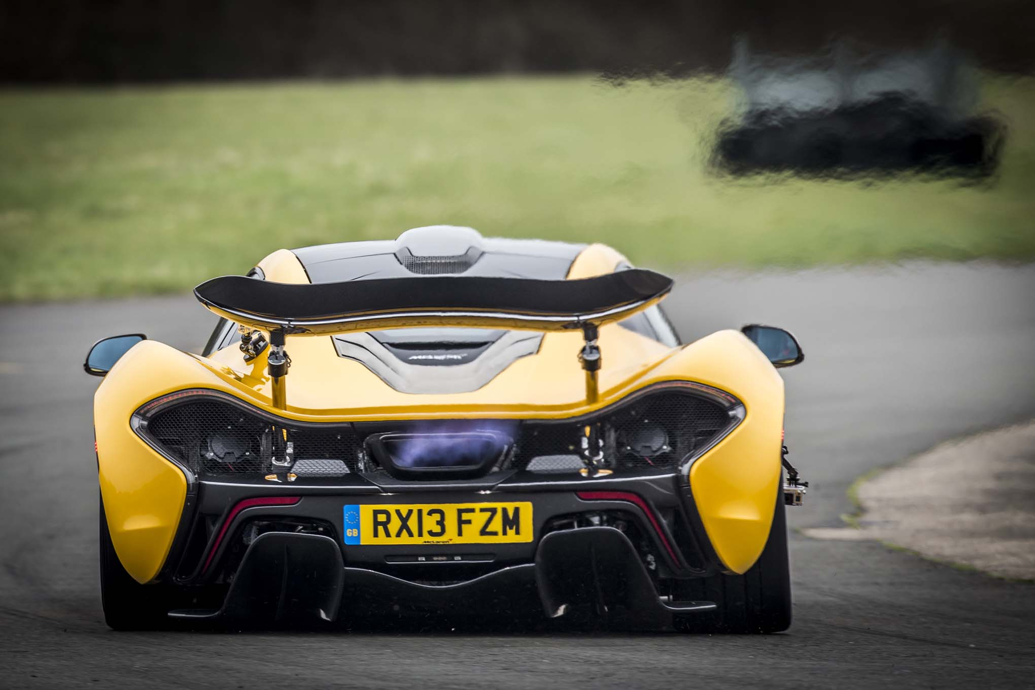 http://st.automobilemag.com/uploads/sites/11/2014/06/2014-Mclaren-P1-yellow-rear-end-in-motion1.jpg