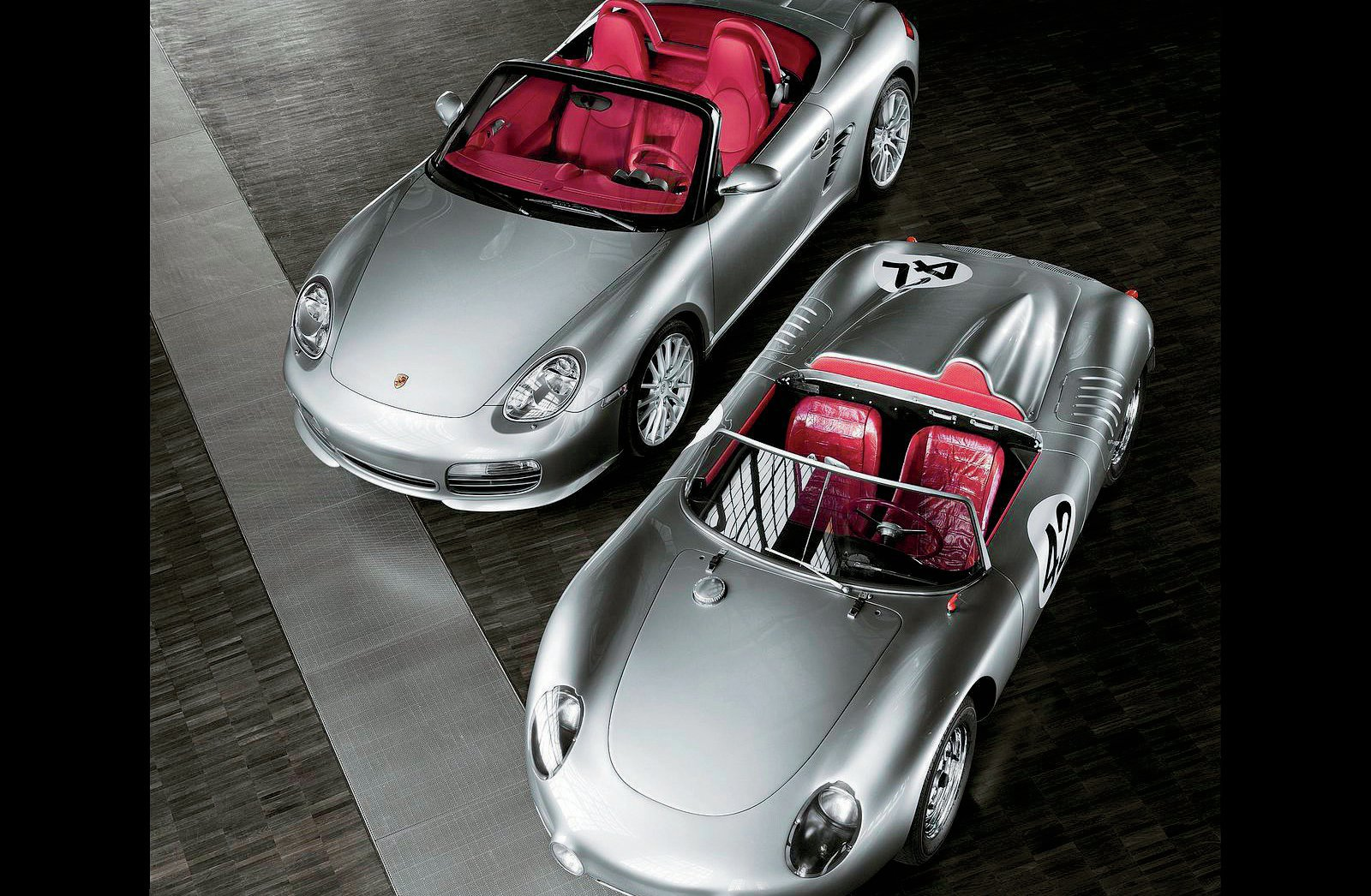 The original Porsche 718 was built between 1957 and 1962. Like its progenitor, the new 718 is a racy, lightweight roadster. The original 718 is shown here with the Boxster RS60 Spyder, of which 1960 were built as a 2008 model.