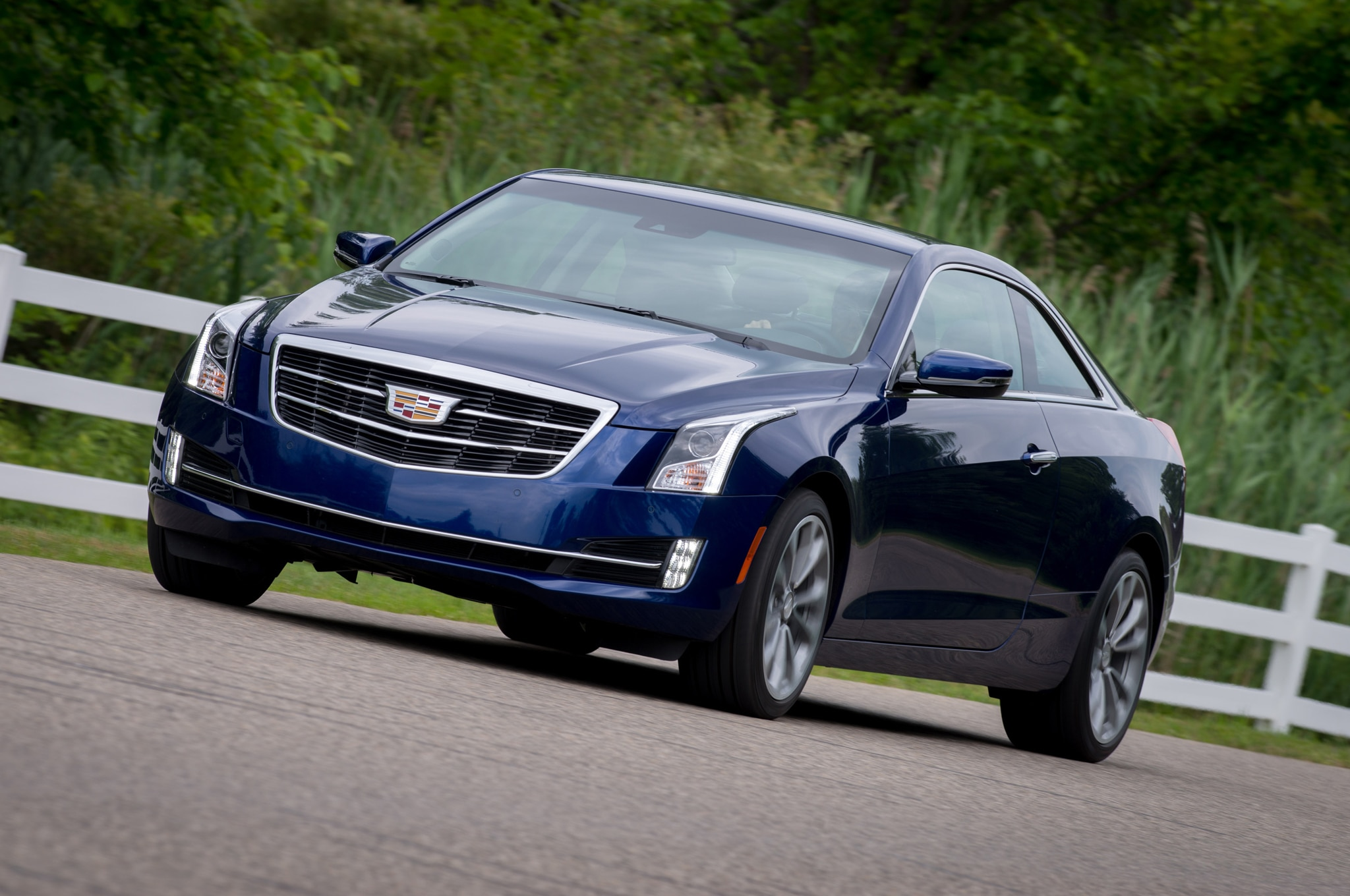 2015 Cadillac ATS Coupe Front Three Quarter In Motion 04