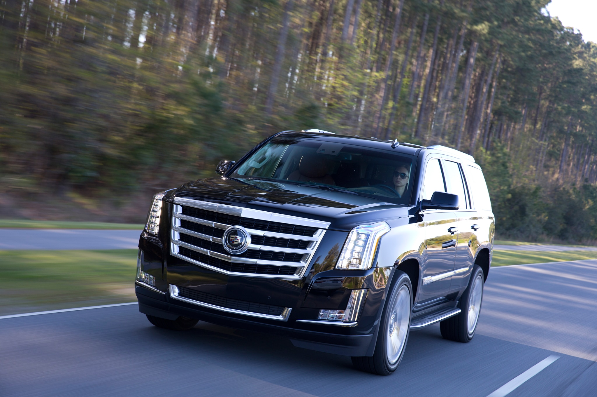 2015 Cadillac Escalade Front Three Quarters In Motion1