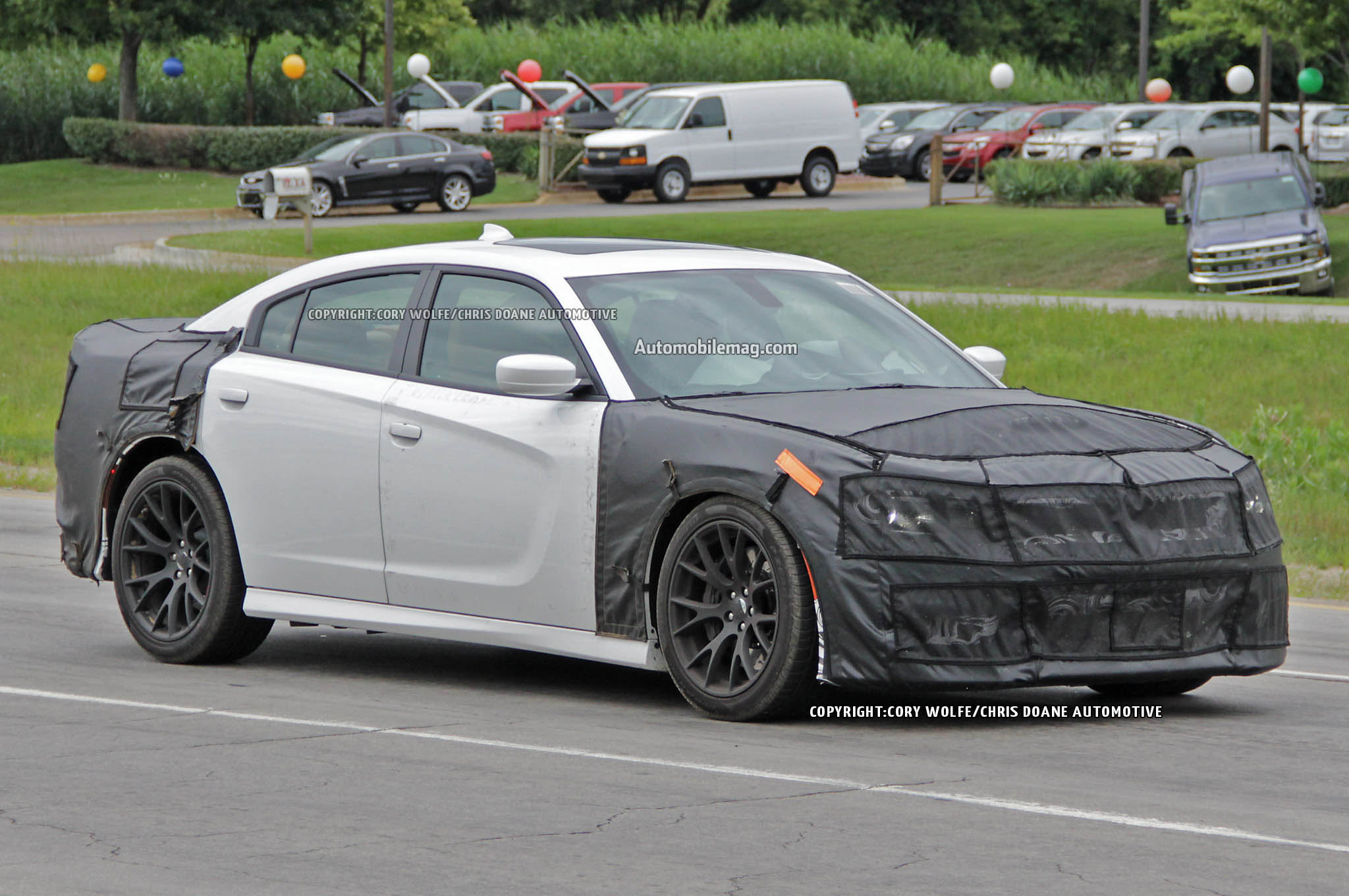 2015 Dodge Charger Srt Hellcat Spied Front Three Quarters 04