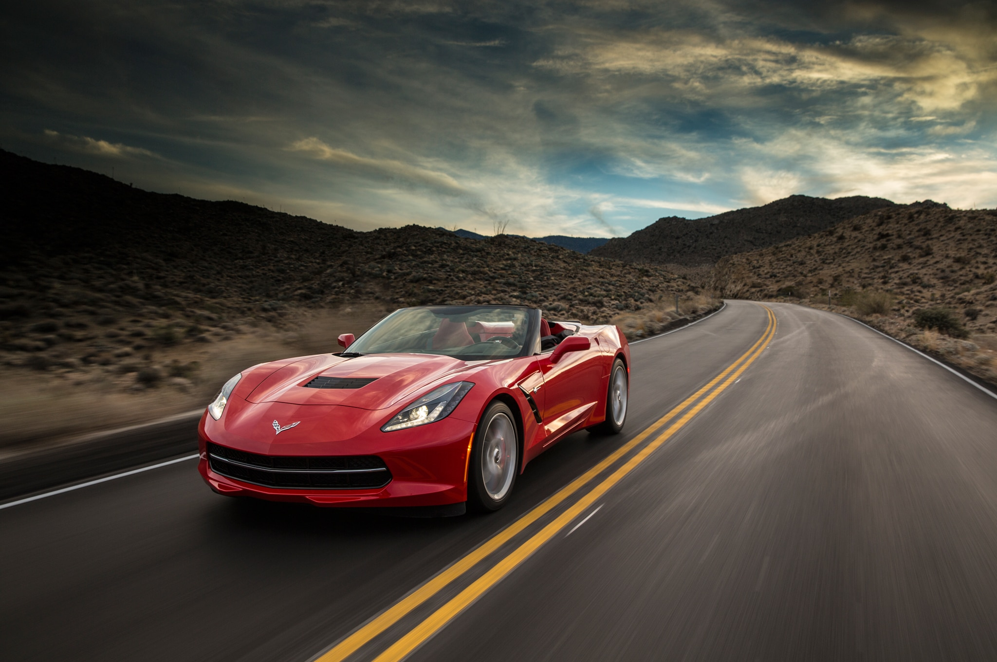 2014 Chevrolet Corvette Stingray Convertible Red Front End In Motion 041