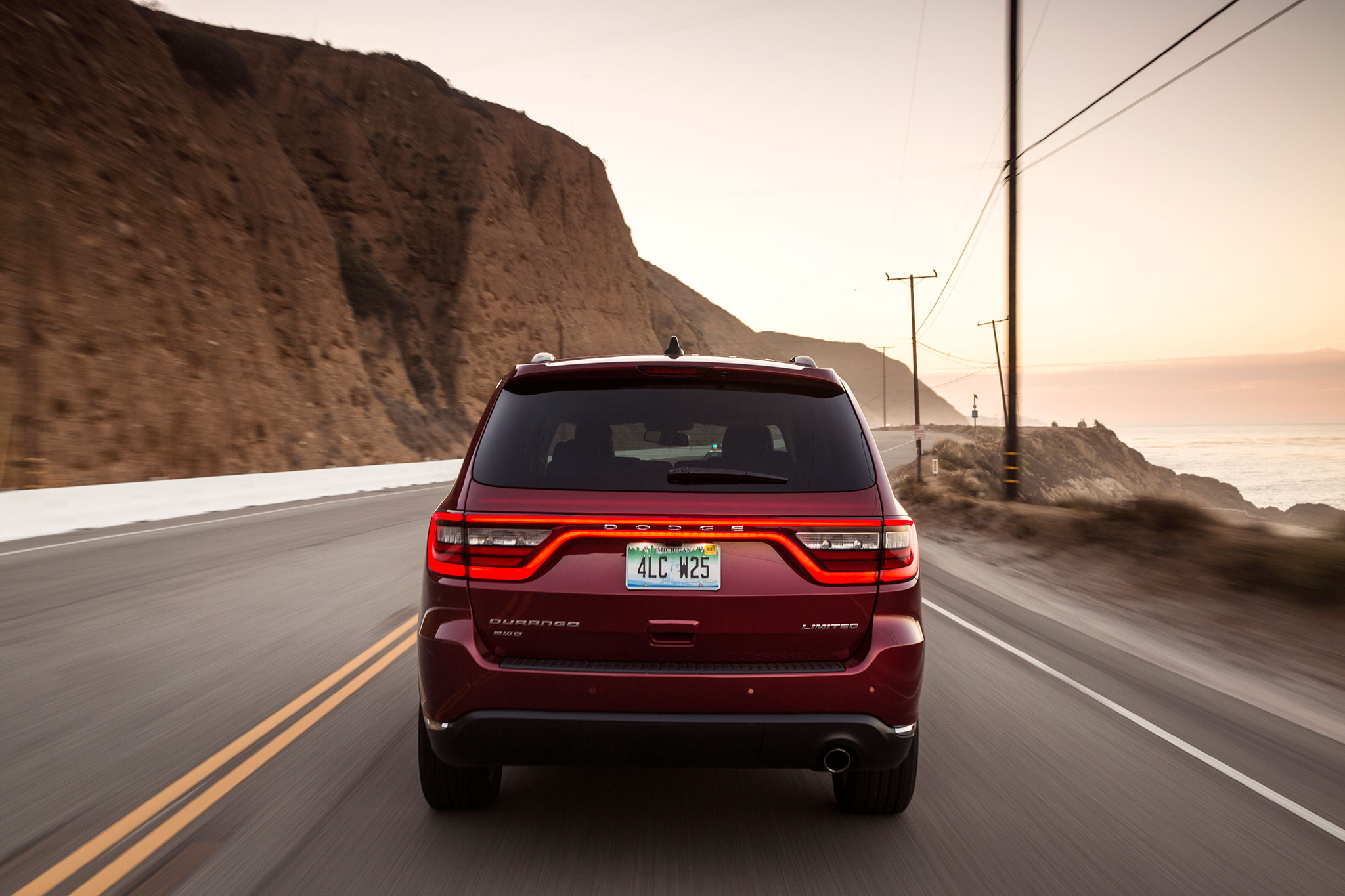 2014 dodge durango limited profile rear in motion. Cars Review. Best American Auto & Cars Review