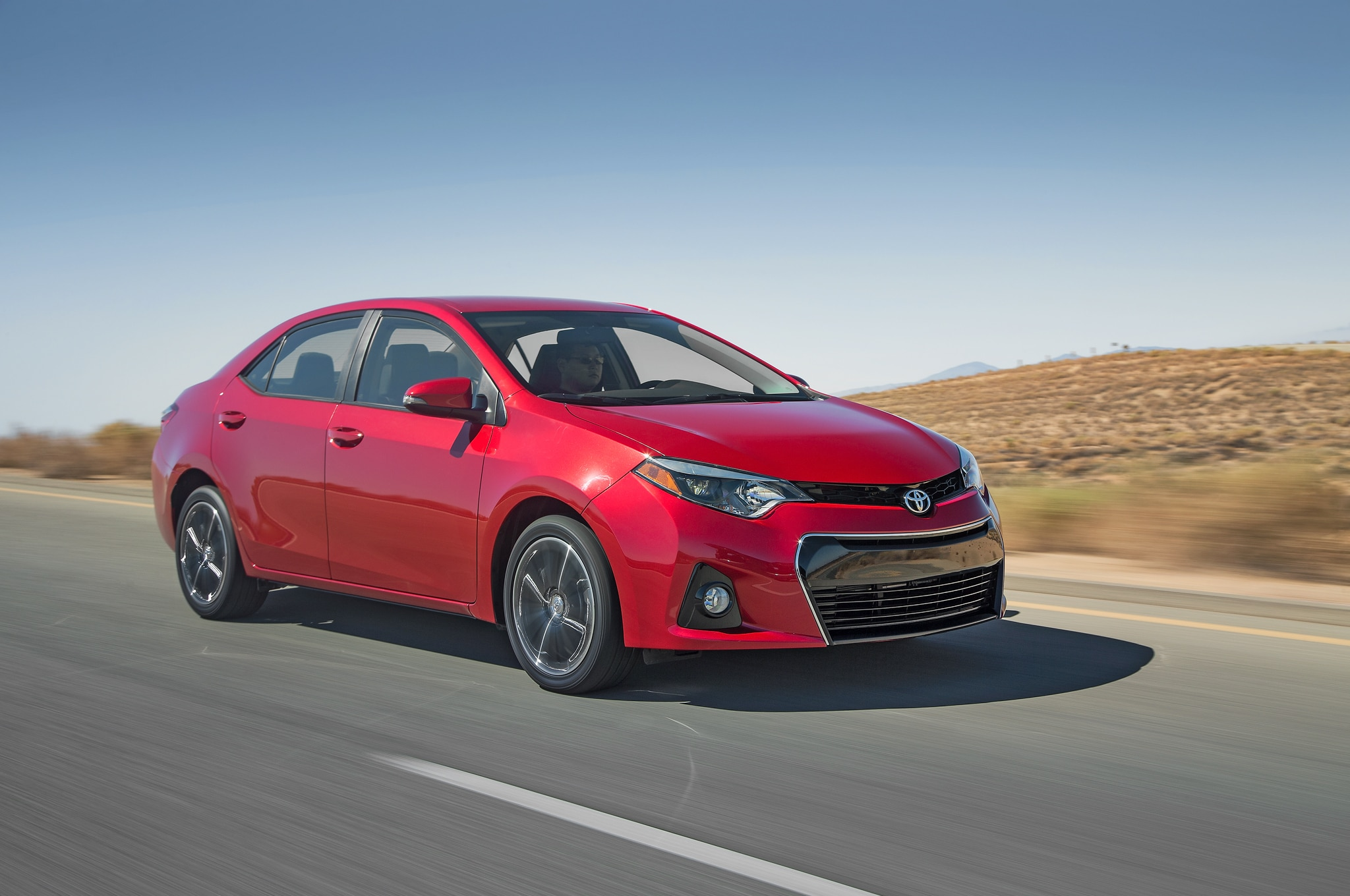 2014 Toyota Corolla S Front Three Quarters In Motion1