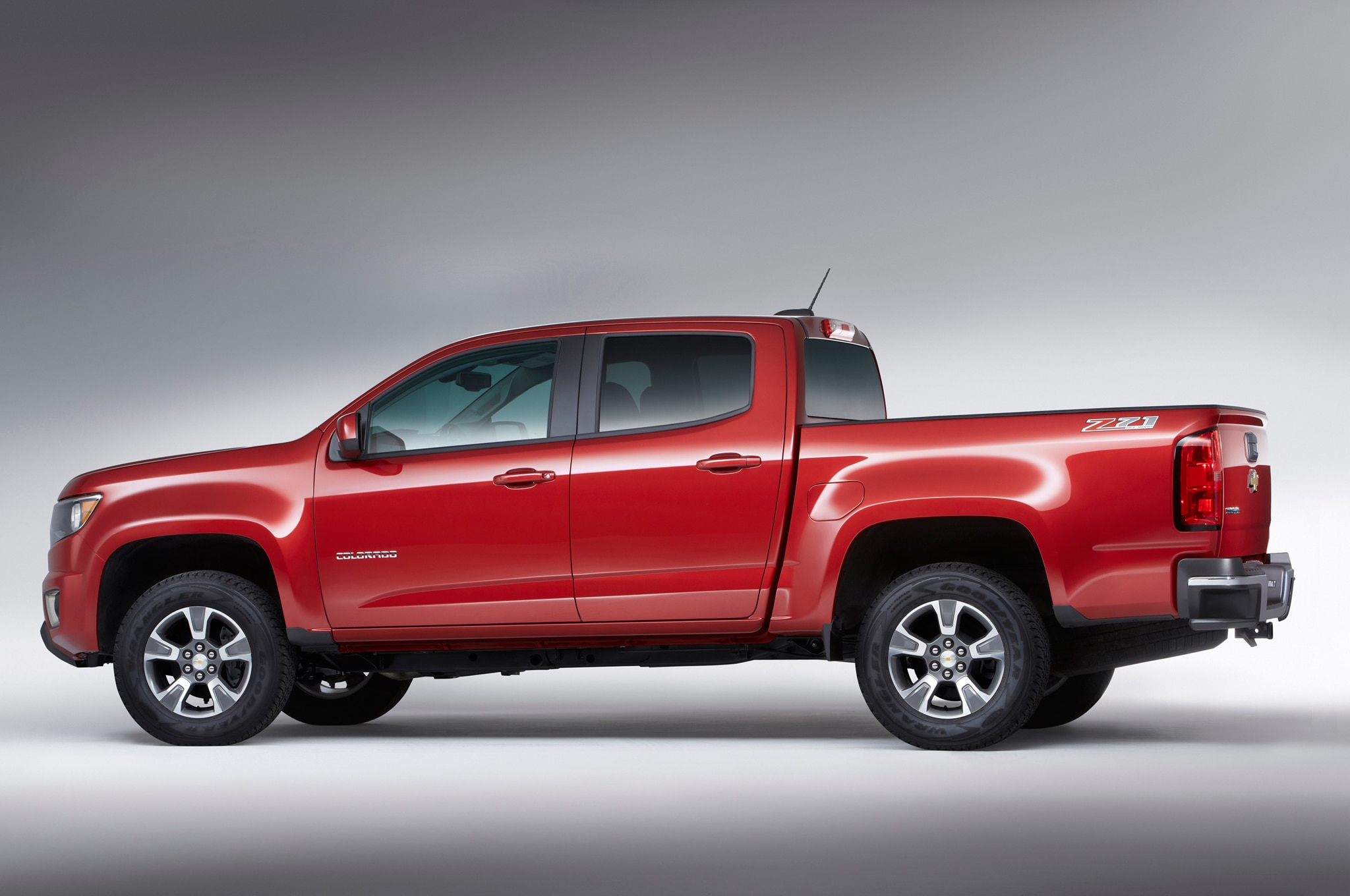 2015 Chevrolet Colorado rear three quarters 2015 chevrolet colorado starts at $20,995, gmc canyon at $21,880 2017 Chevy Colorado GMC Canyon at honlapkeszites.co