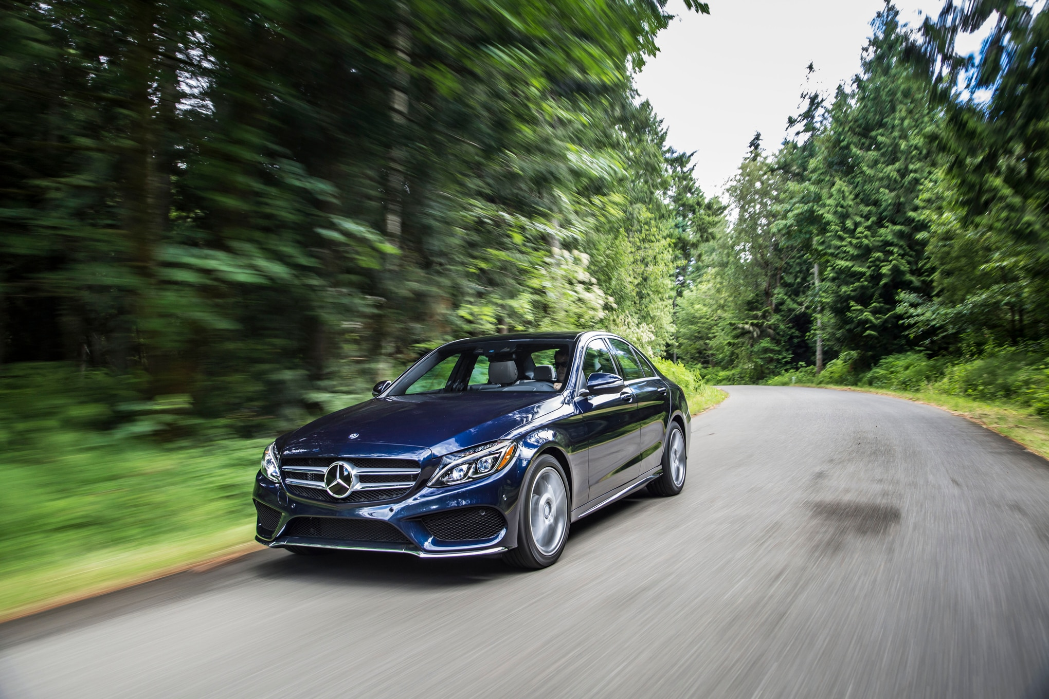 2015 Mercedes Benz C400 4Matic Front Three Quarter In Motion 051