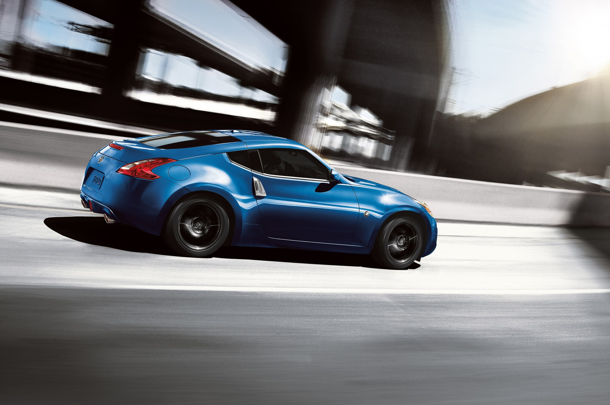 2015 Nissan 370Z Coupe Rear Three Quarter In Motion2