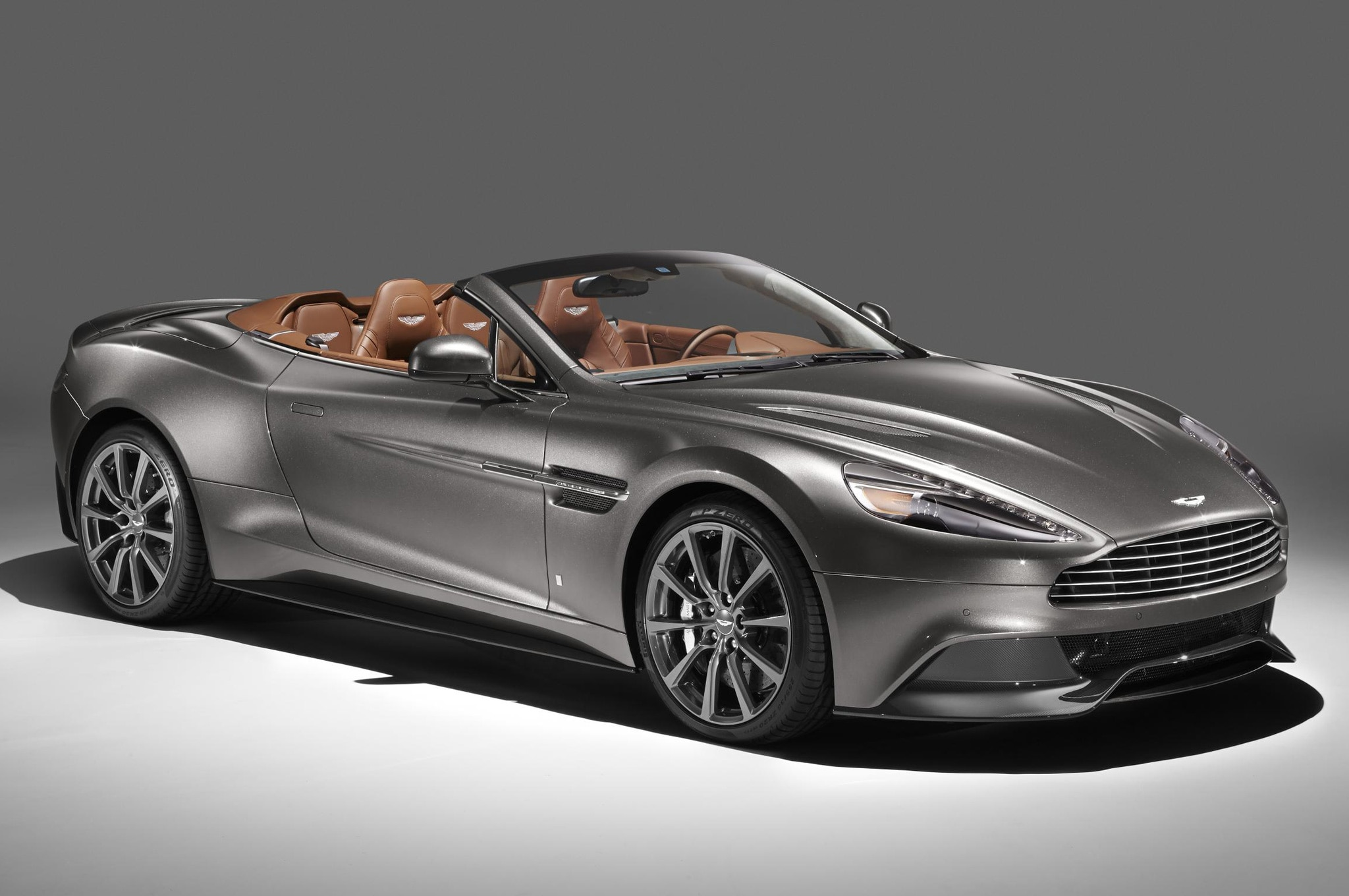 "four bespoke ""qaston martin"" cars shown at monterey"