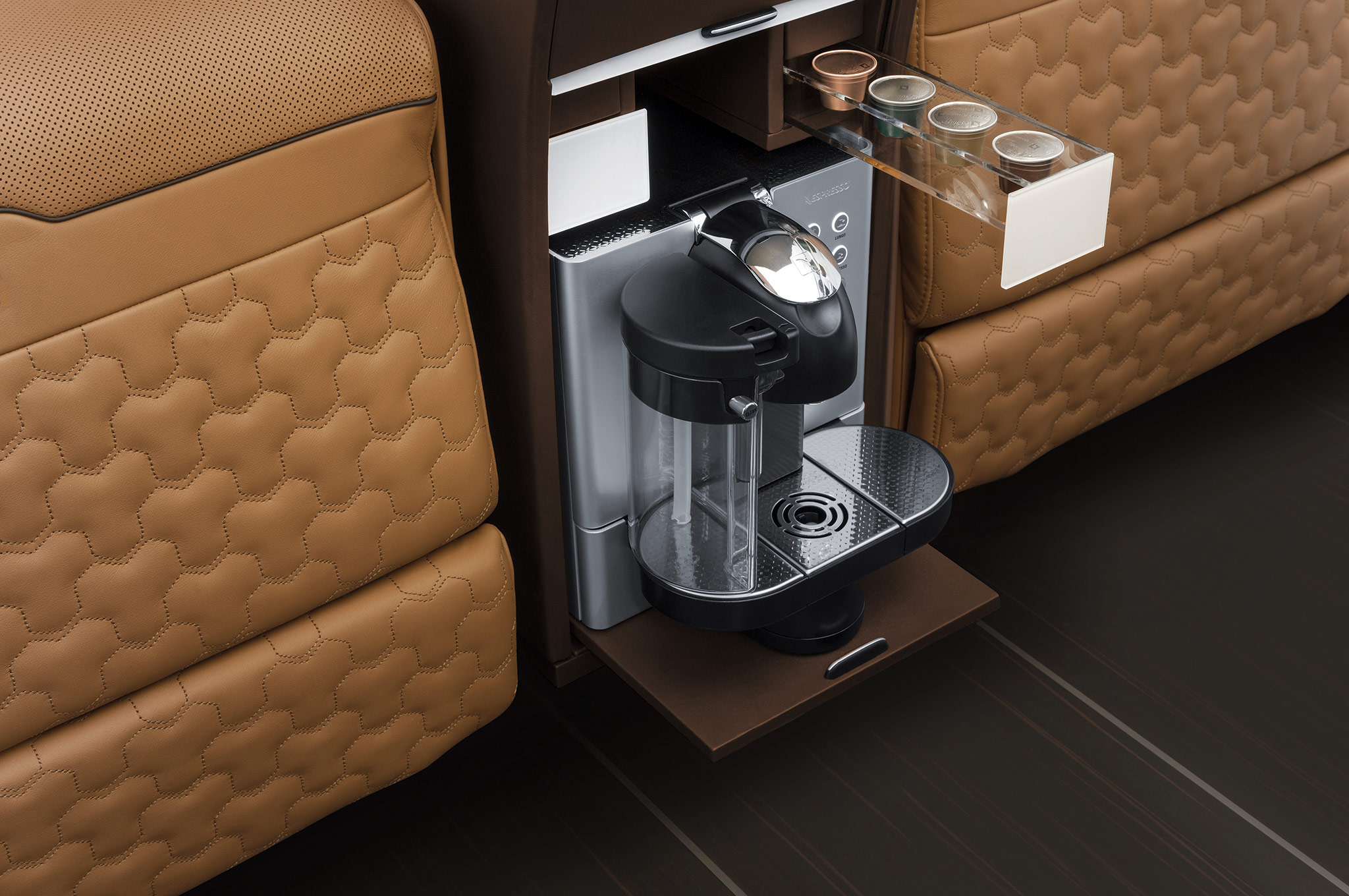 ' ' from the web at 'http://st.automobilemag.com/uploads/sites/11/2014/08/Brabus-Mercedes-Benz-Sprinter-Business-Lounge-coffee-machine.jpg'