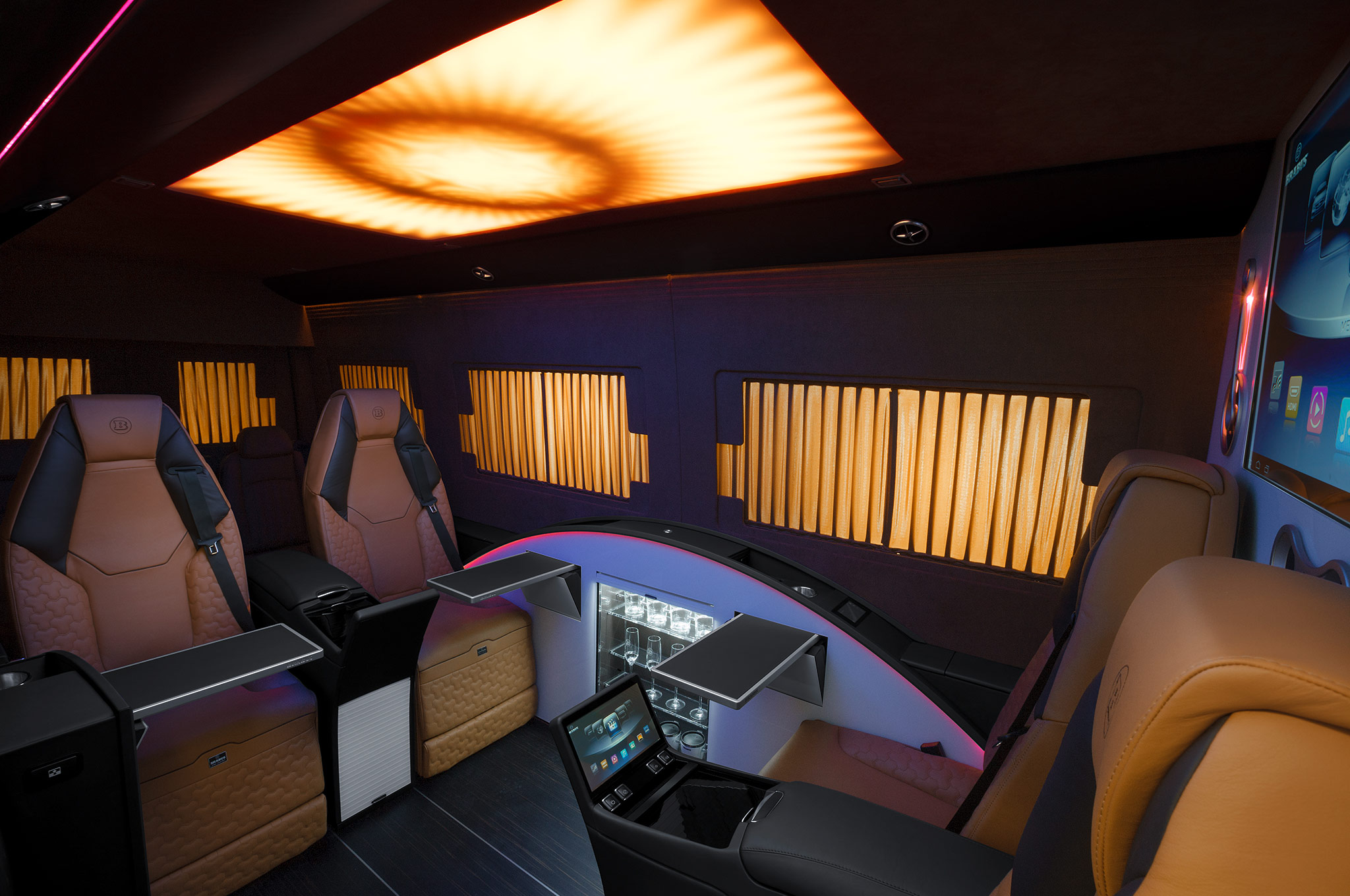 ' ' from the web at 'http://st.automobilemag.com/uploads/sites/11/2014/08/Brabus-Mercedes-Benz-Sprinter-Business-Lounge-interior-lights-dimmed.jpg'