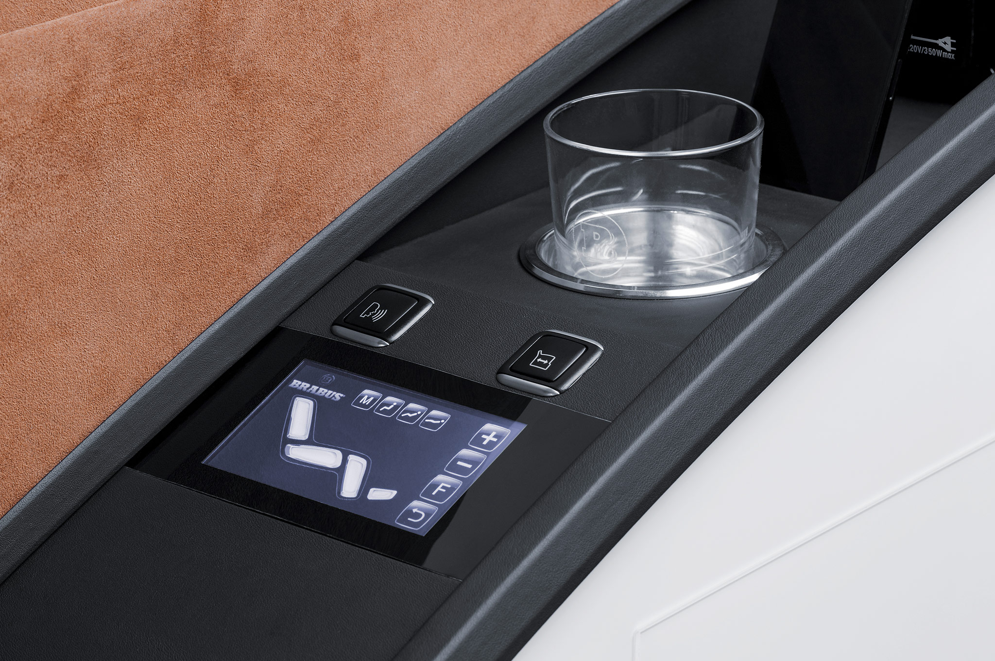 ' ' from the web at 'http://st.automobilemag.com/uploads/sites/11/2014/08/Brabus-Mercedes-Benz-Sprinter-Business-Lounge-seat-controller.jpg'