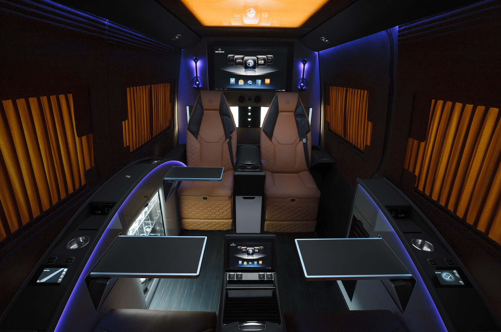 ' ' from the web at 'http://st.automobilemag.com/uploads/sites/11/2014/08/Brabus-Mercedes-Benz-Sprinter-Business-Lounge-seats-with-tables-night.jpg'