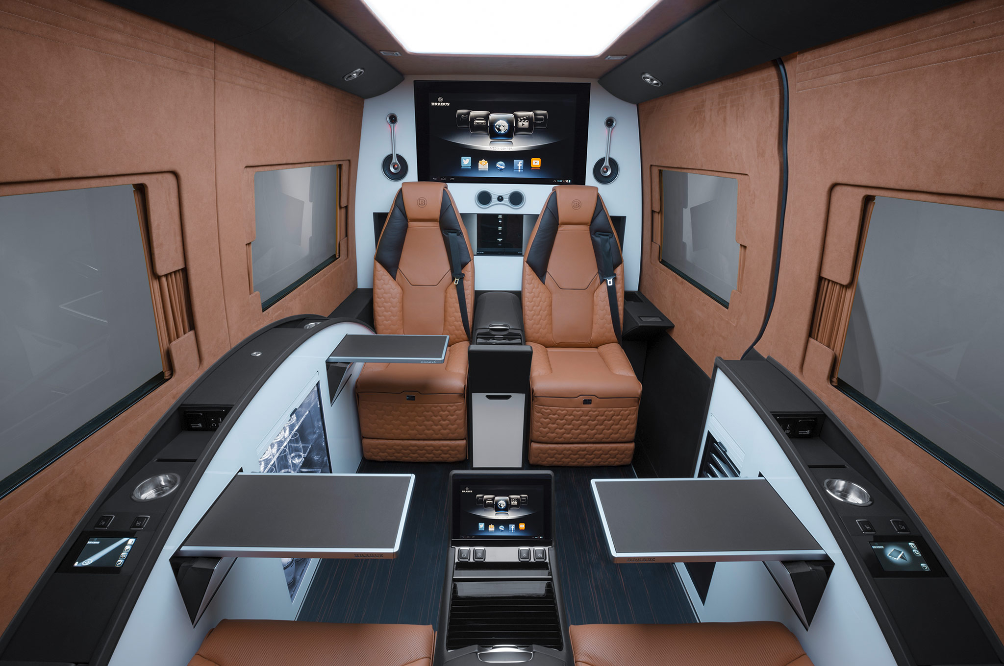 ' ' from the web at 'http://st.automobilemag.com/uploads/sites/11/2014/08/Brabus-Mercedes-Benz-Sprinter-Business-Lounge-seats-with-tables.jpg'