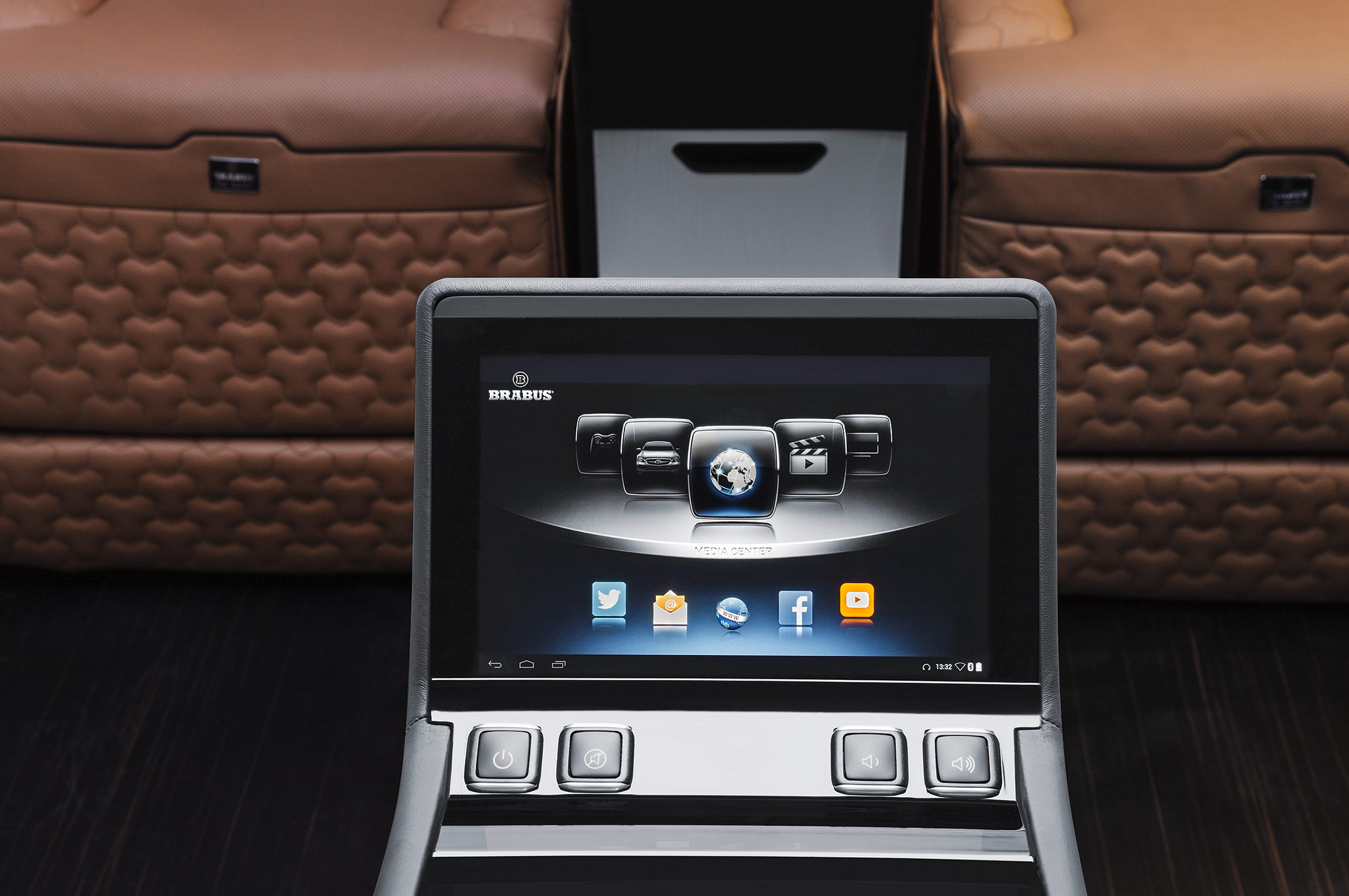 ' ' from the web at 'http://st.automobilemag.com/uploads/sites/11/2014/08/Brabus-Mercedes-Benz-Sprinter-Business-Lounge-touchscreen-controller.jpg'