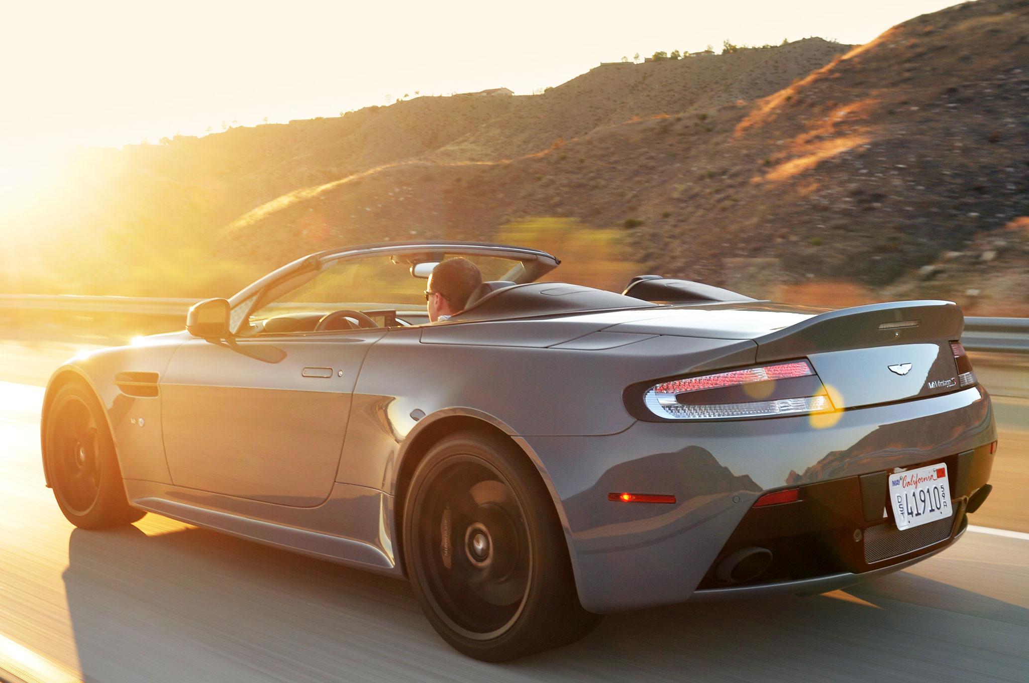 Aston Martin V Vantage S Roadster Rear Three Quarter View In Motion on Driven 2015 Aston Martin V12 Vantage S Roadster Review