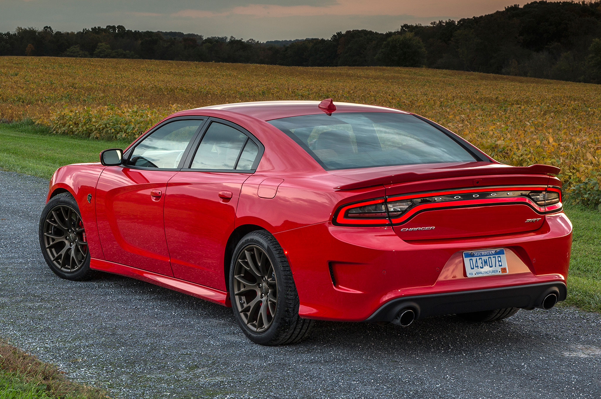 rear three dodge compared view srt charger review hellcat quarter news