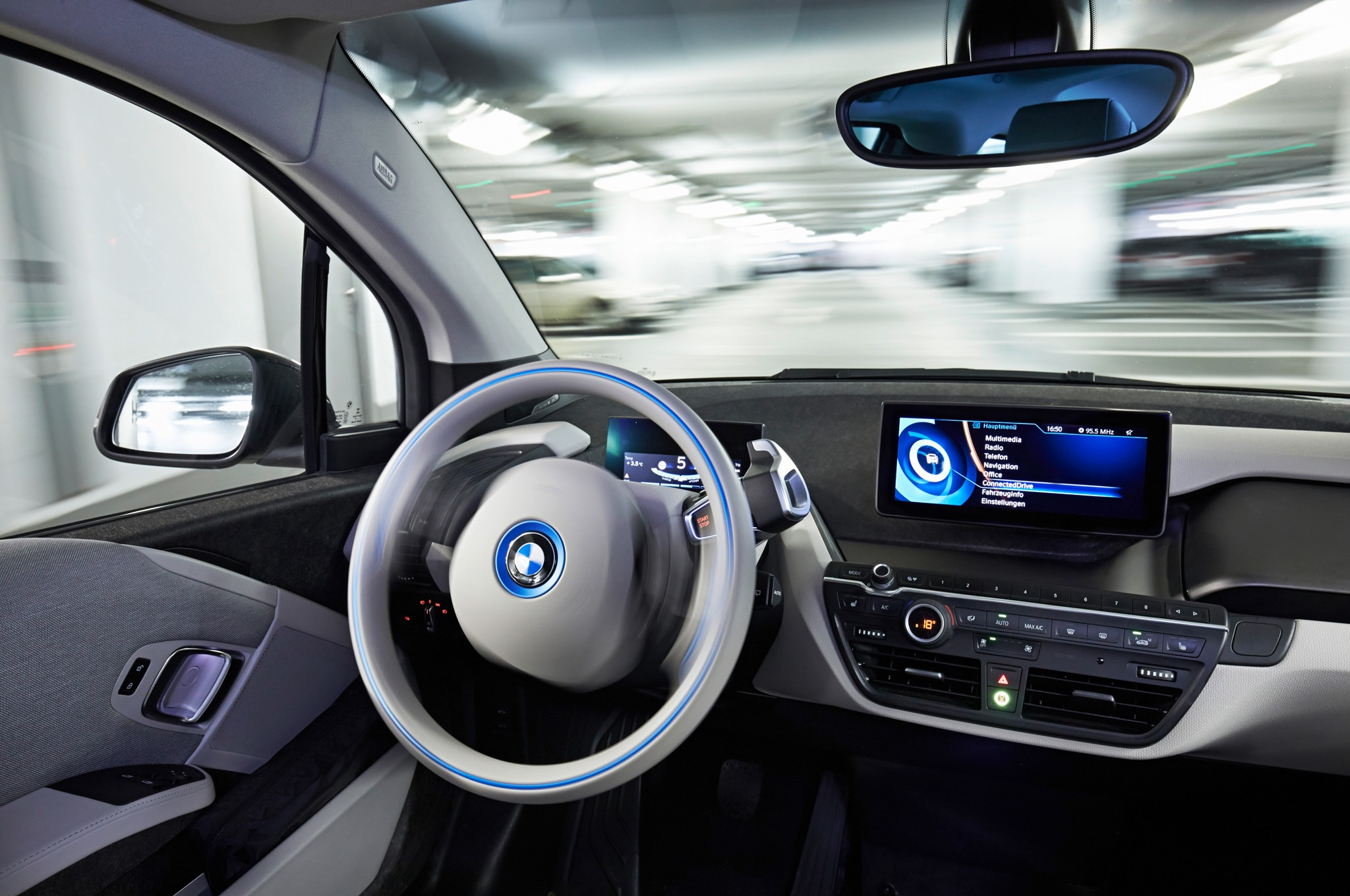 bmw to demonstrate active assist remote valet parking at ces  2014 bmw i3 edrive remote valet parking interior 02