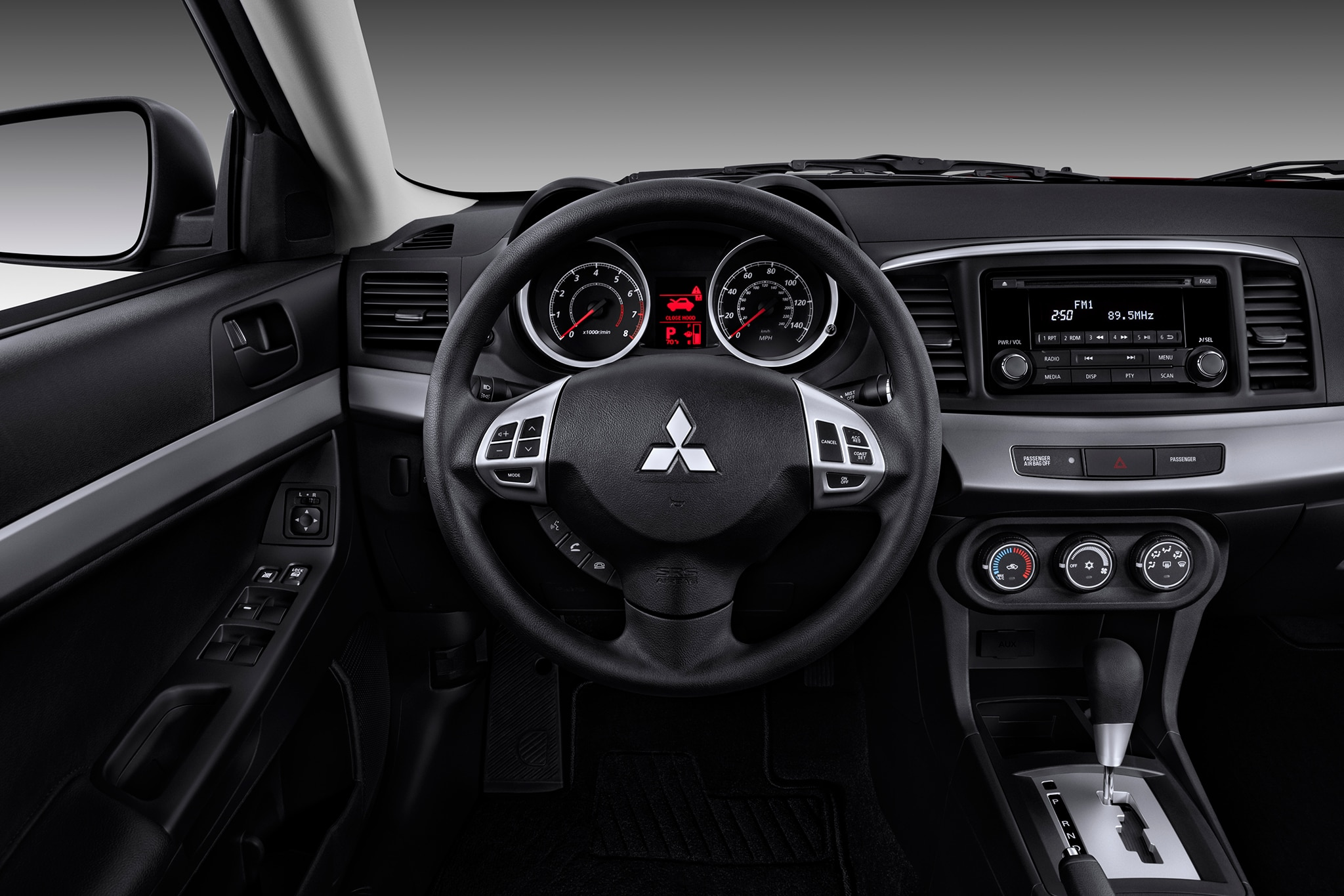 http://st.automobilemag.com/uploads/sites/11/2014/12/2014-Mitsubishi-Lancer-GT-dash-steering-wheel-view-1.jpg
