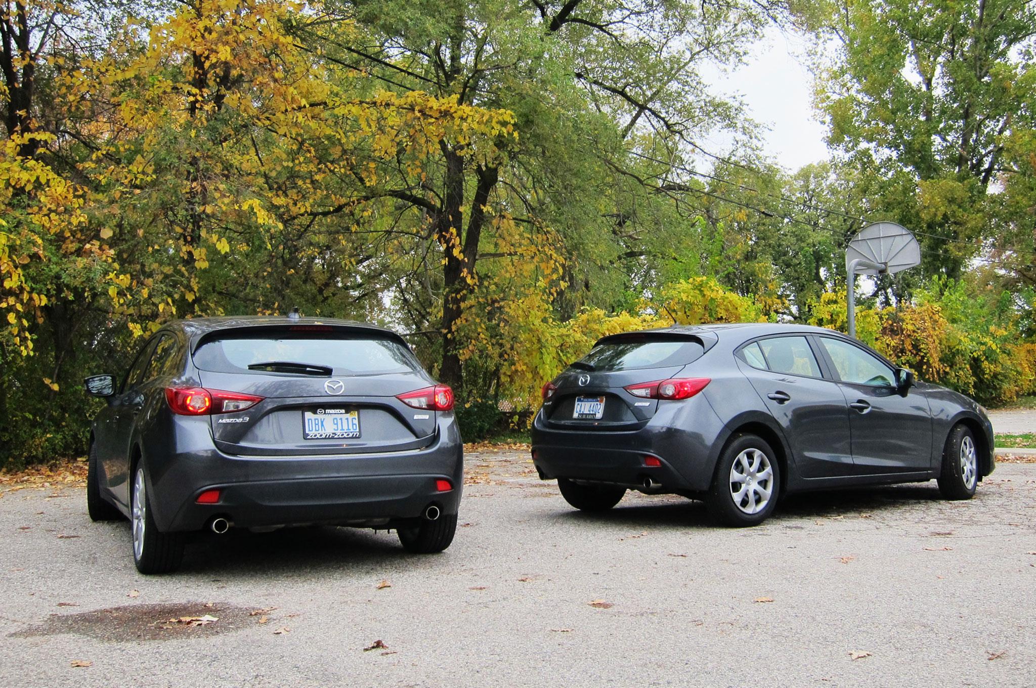 http://st.automobilemag.com/uploads/sites/11/2015/01/2014-Mazda-3-s-Touring-rear-three-quarter-view-model-set-2.jpg