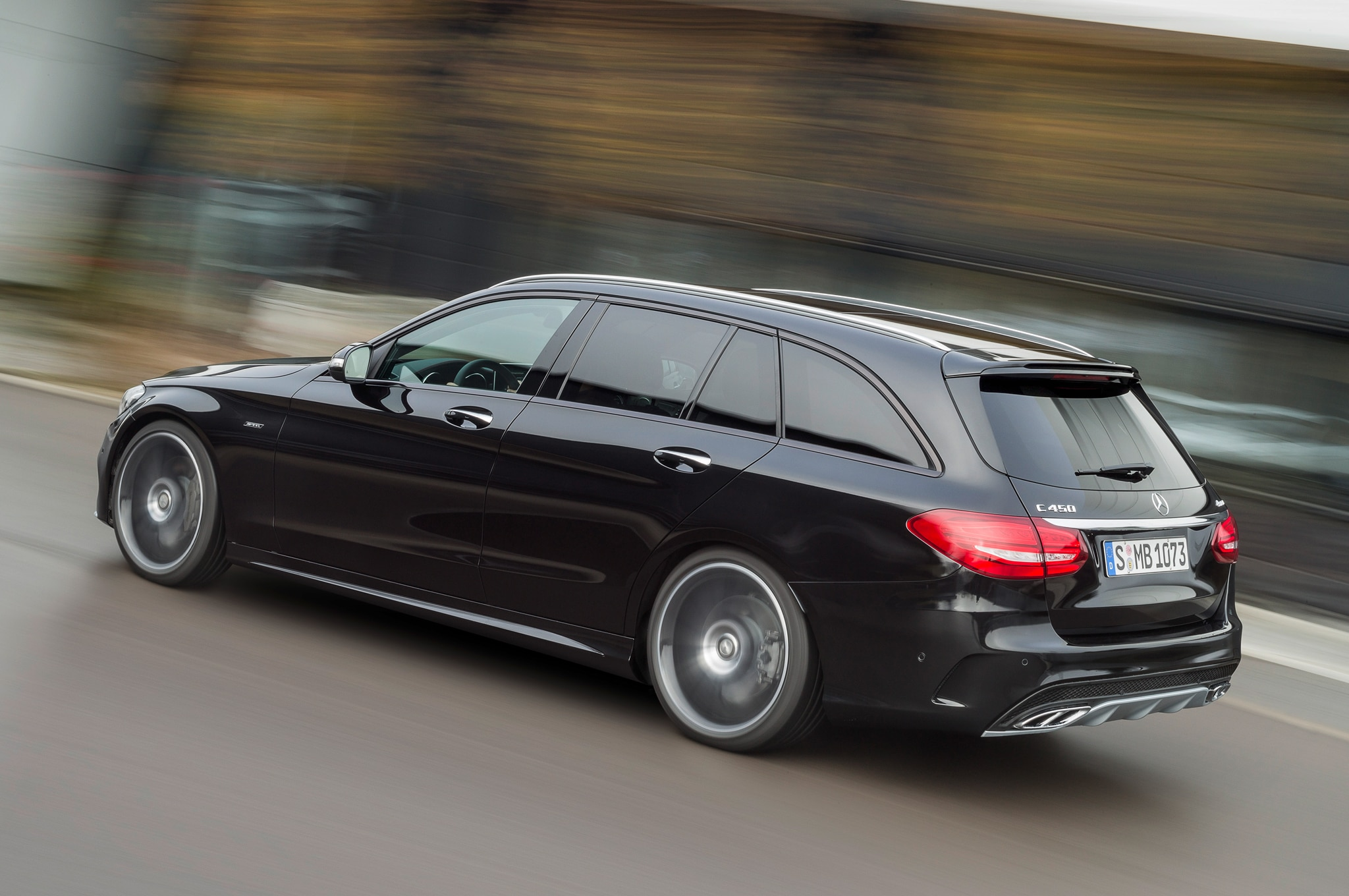 http://st.automobilemag.com/uploads/sites/11/2015/01/2016-Mercedes-Benz-C450-AMG-4Matic-wagon-rear-motion-view.jpg