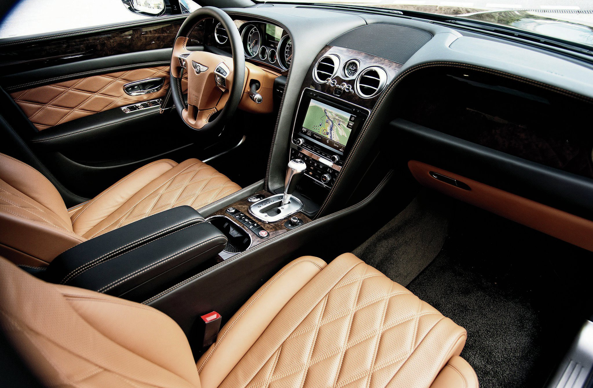 reviews flying door front bentley canada and sedan motor price cars angular rating en spur trend