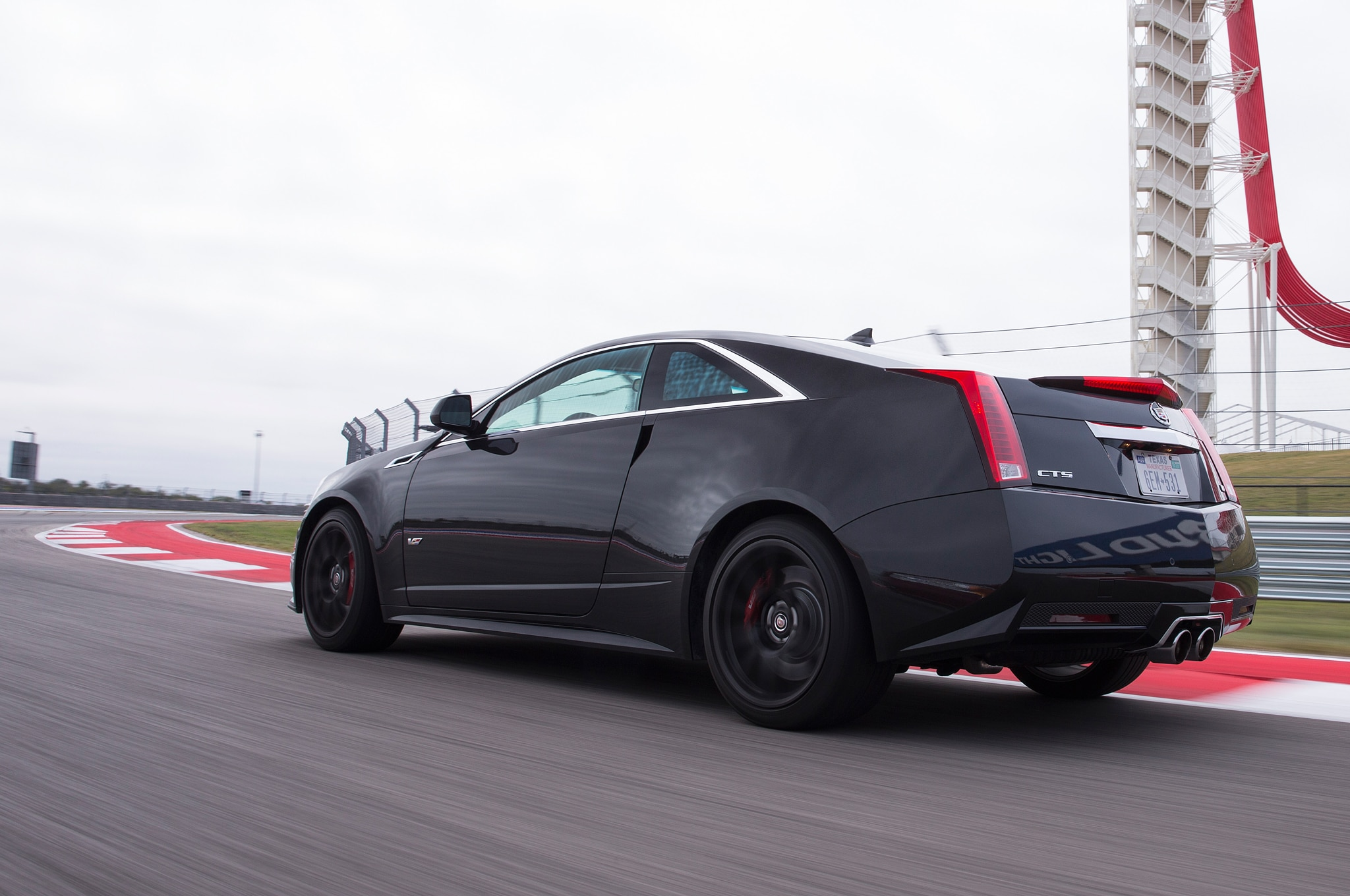 2015 cadillac cts v coupe rear three quarter in motion. Cars Review. Best American Auto & Cars Review