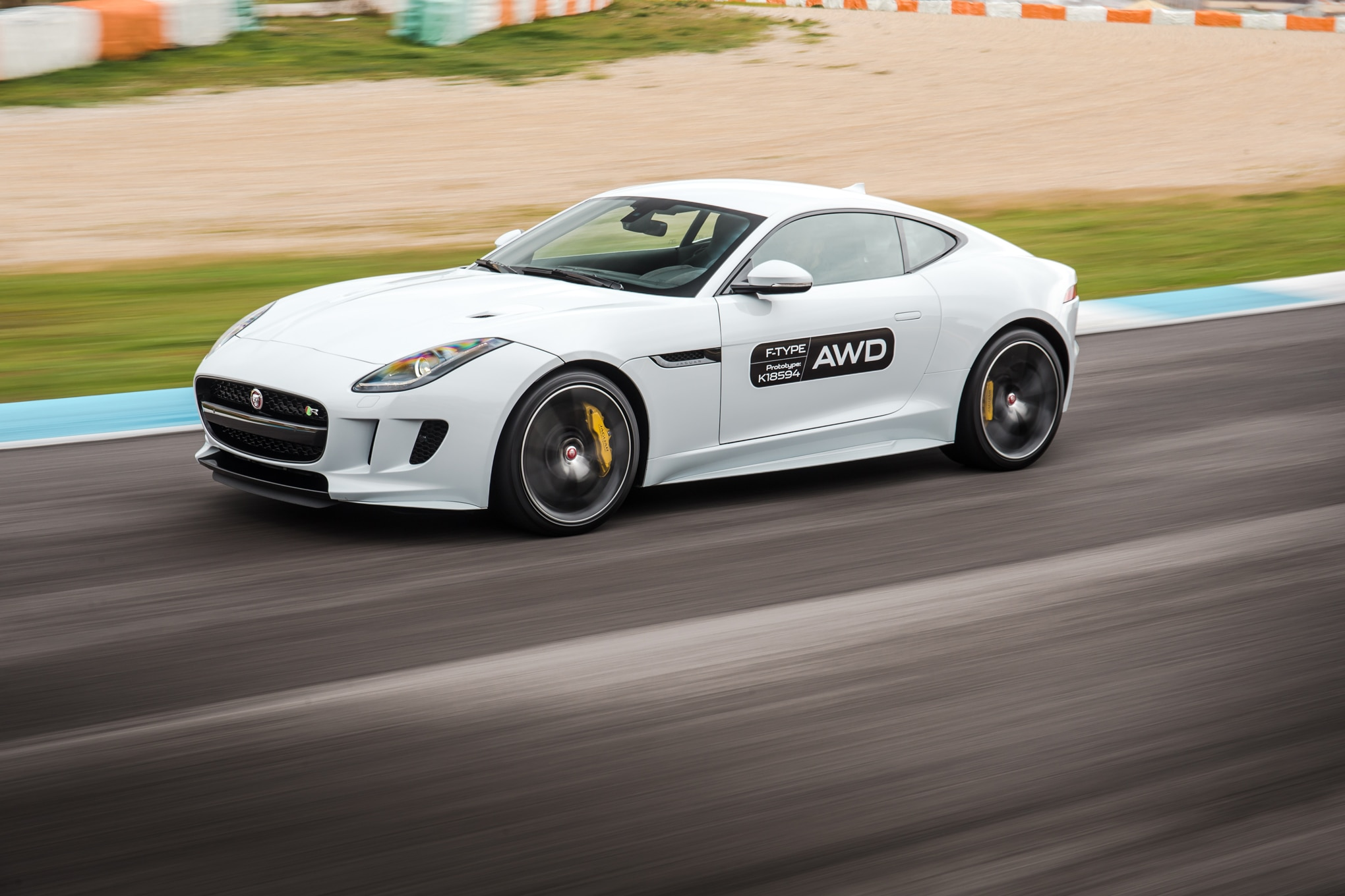 2016 Jaguar F Type R AWD Front Three Quarter In Motion 08