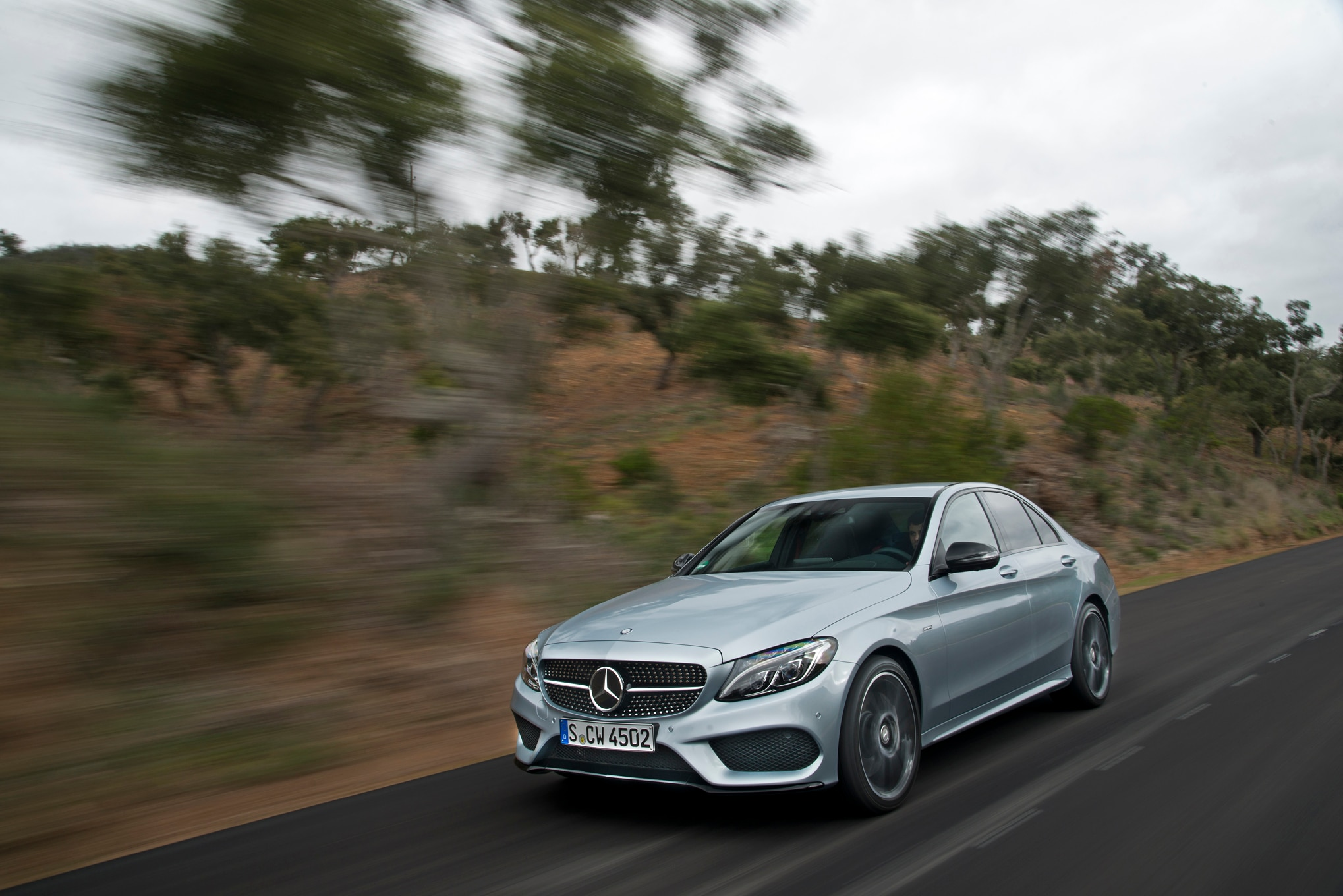 http://st.automobilemag.com/uploads/sites/11/2015/02/2016-Mercedes-Benz-C450-AMG-4Matic-front-three-quarter-in-motion-03.jpg