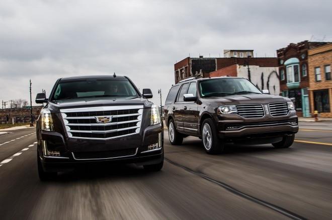2015 Cadillac Escalade And 2015 Lincoln Navigator Moving Car To Car 1 660x438