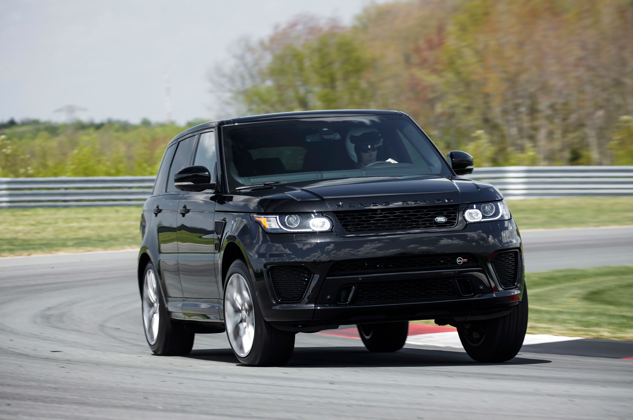 http://st.automobilemag.com/uploads/sites/11/2015/05/2015-Land-Rover-Range-Rover-Sport-SVR-front-three-quarter-in-motion-07.jpg
