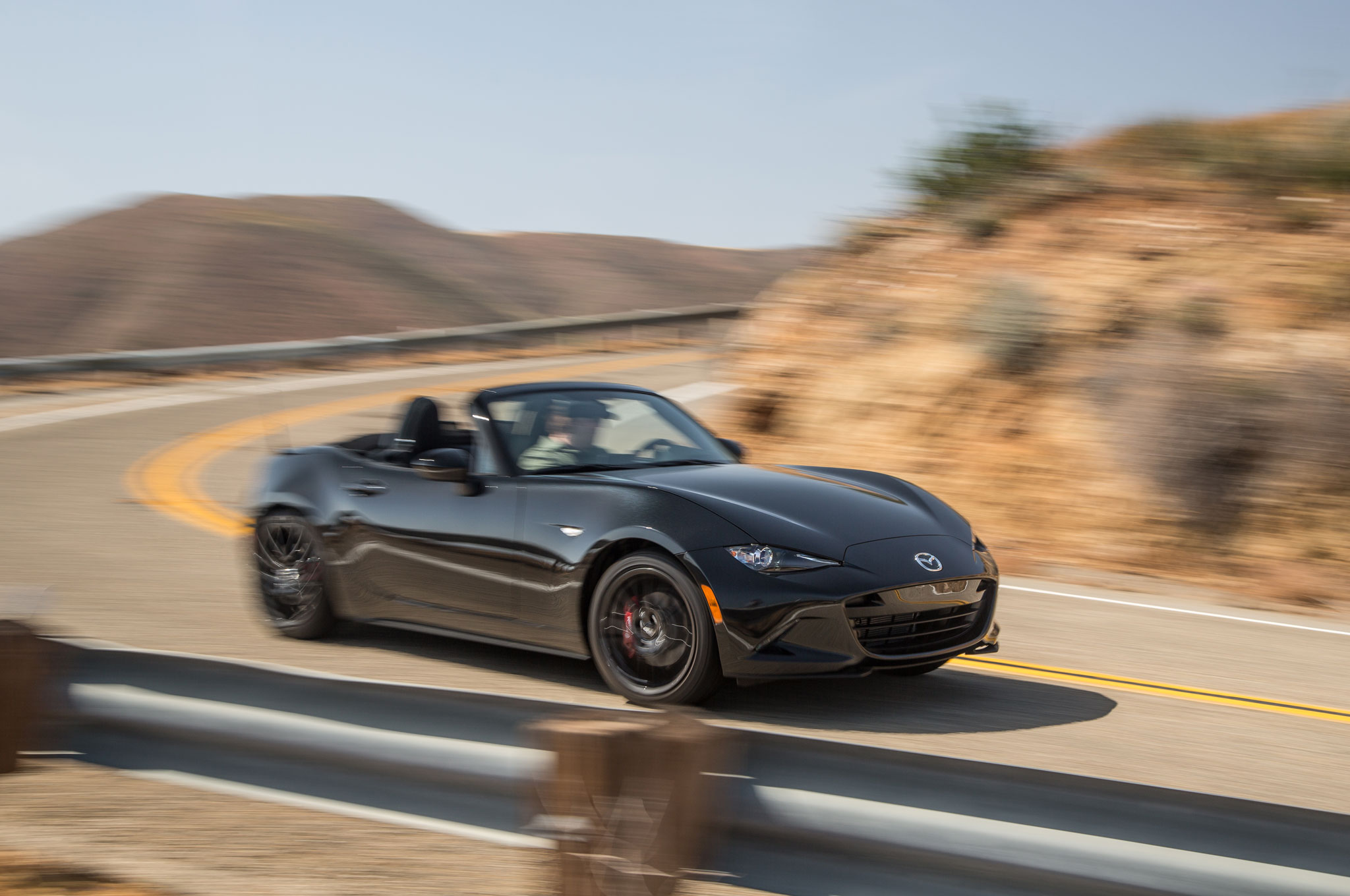 http://st.automobilemag.com/uploads/sites/11/2015/06/2016-Mazda-MX-5-Miata-Club-front-three-quarter-in-motion-02.jpg