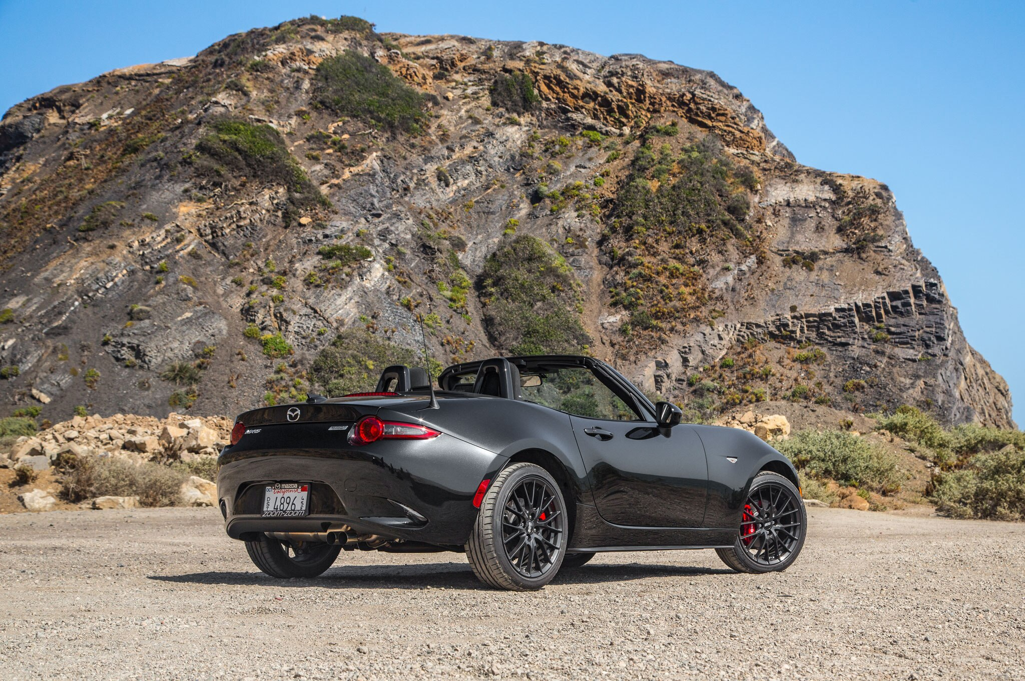 http://st.automobilemag.com/uploads/sites/11/2015/06/2016-Mazda-MX-5-Miata-Club-rear-three-quarter-03.jpg