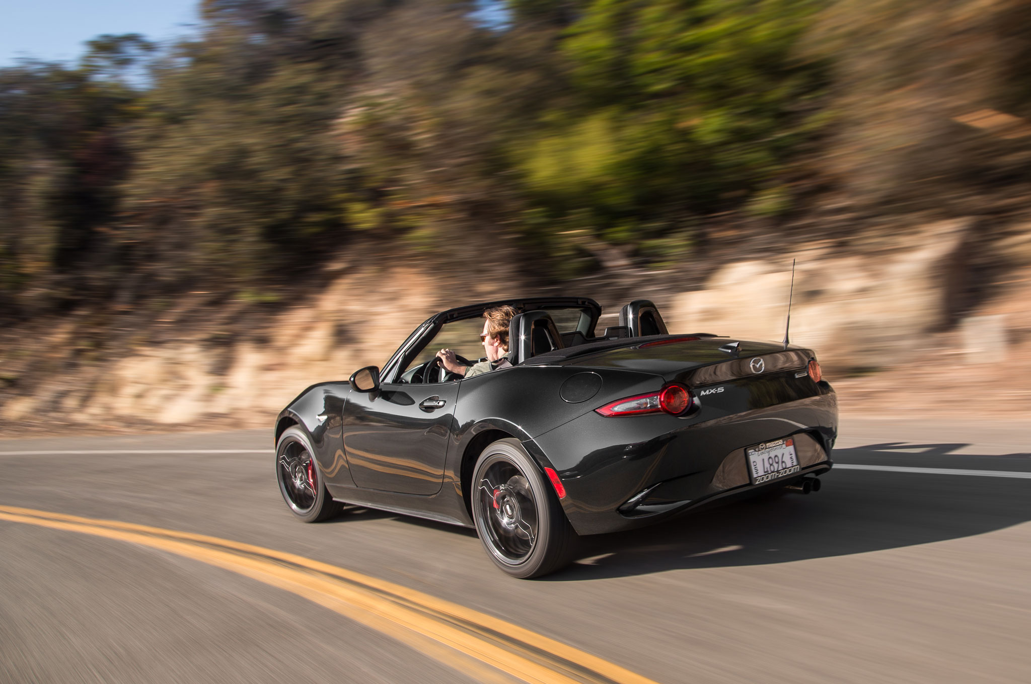 http://st.automobilemag.com/uploads/sites/11/2015/06/2016-Mazda-MX-5-Miata-Club-rear-three-quarter-in-motion-02.jpg