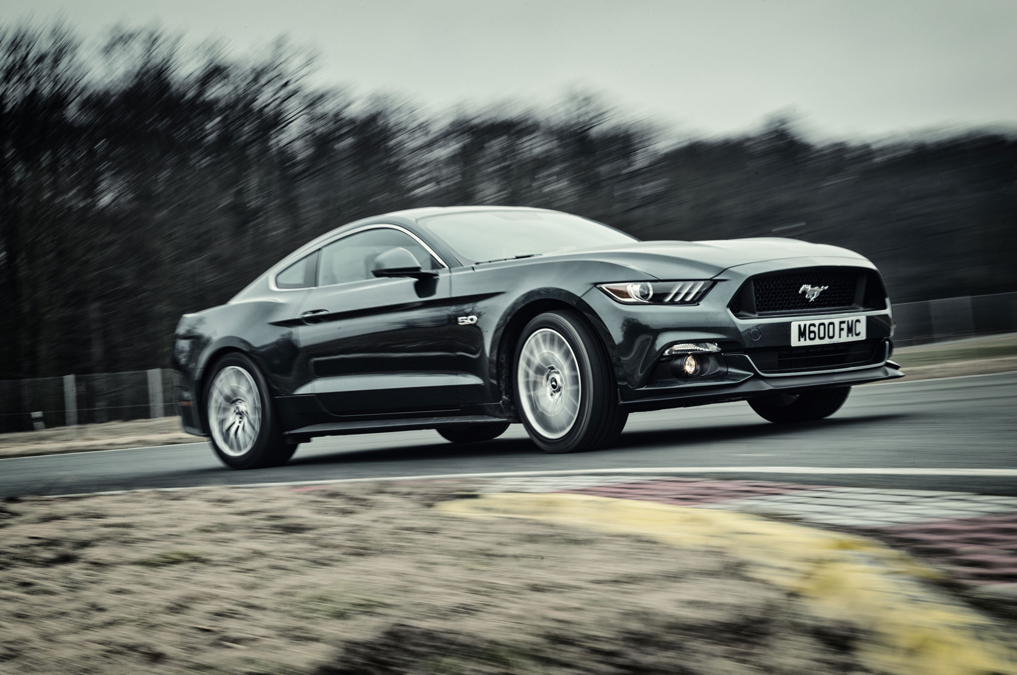 2015 Ford Mustang GT Front Three Quarter In Motion 01