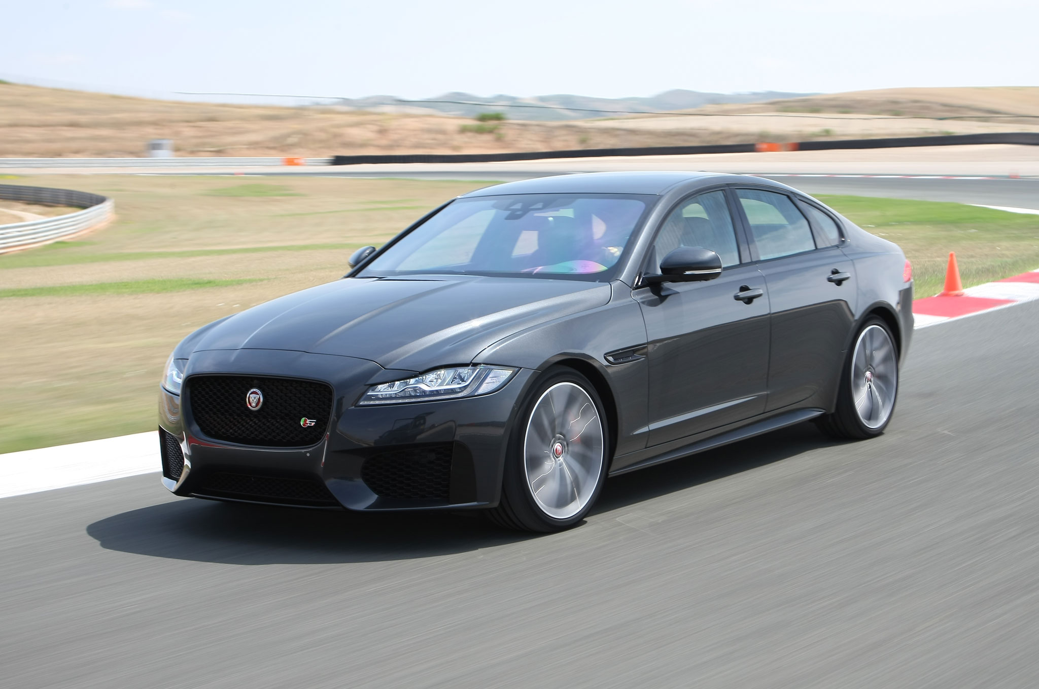 three in show xf review at front motion jaguar for news sport track sale awd more quarter