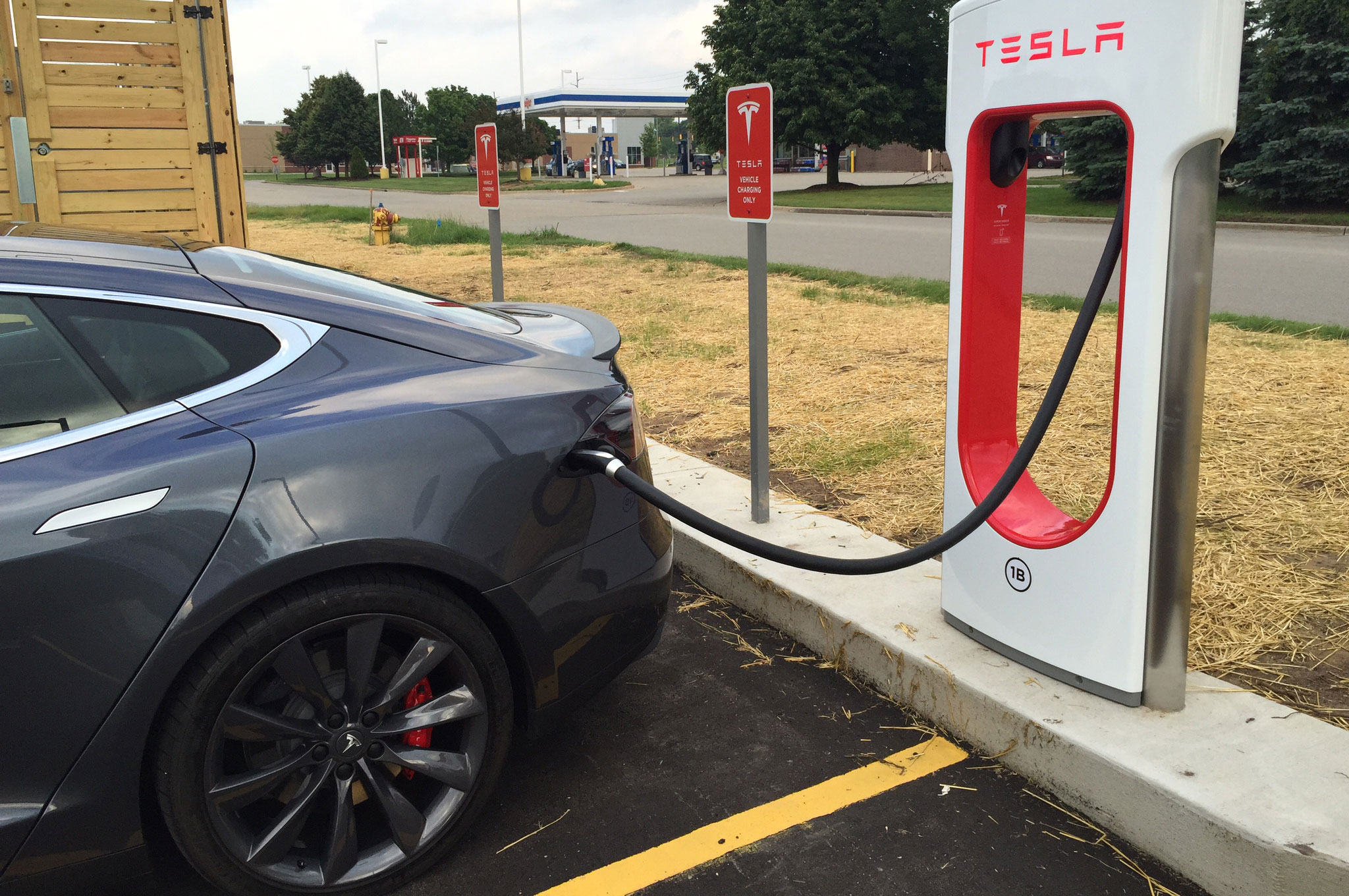 Supercharging A Tesla Model S At A Grocery Store