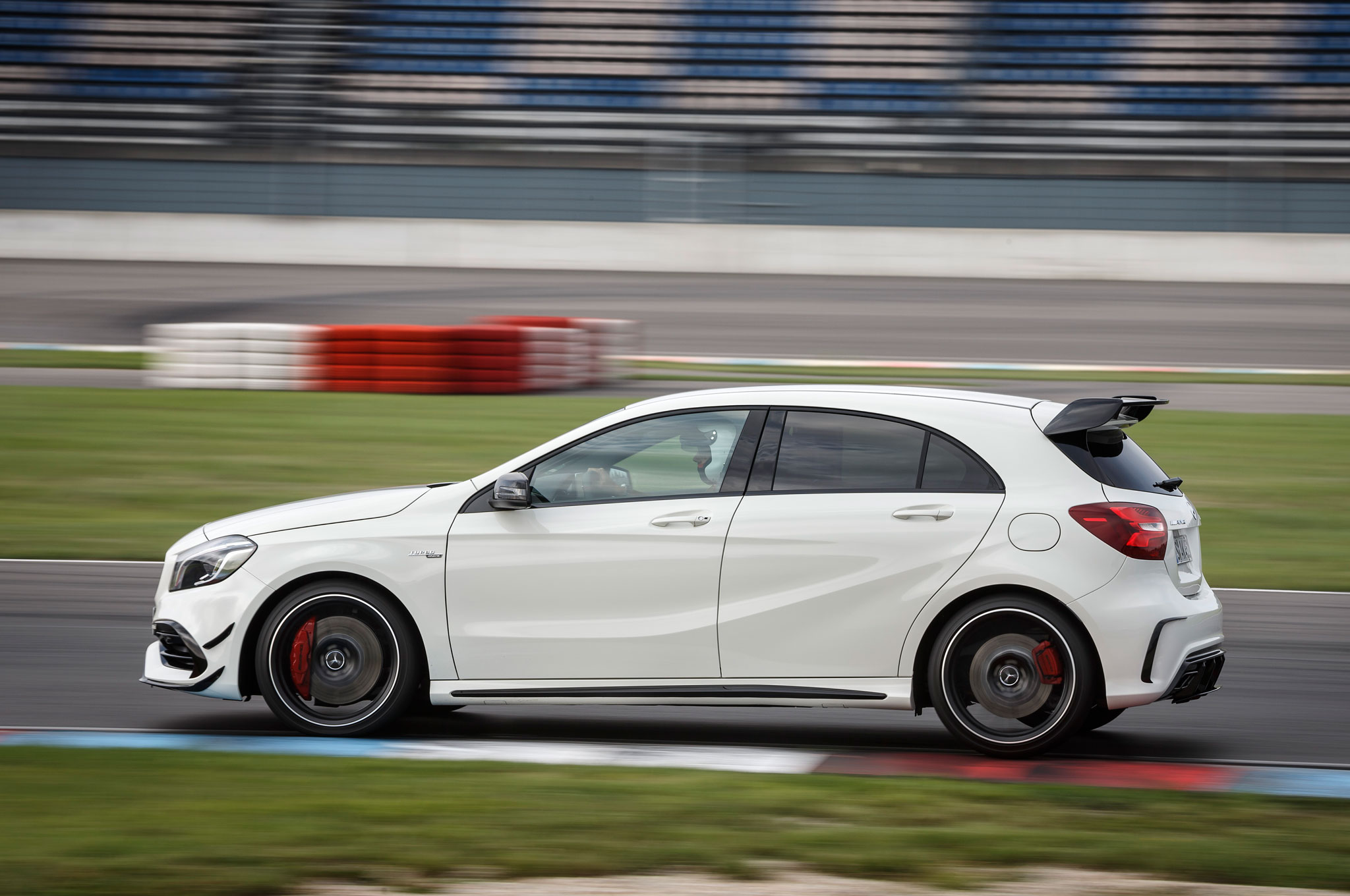 http://st.automobilemag.com/uploads/sites/11/2015/09/2016-Mercedes-AMG-A45-4Matic-side-profile-in-motion-01.jpg