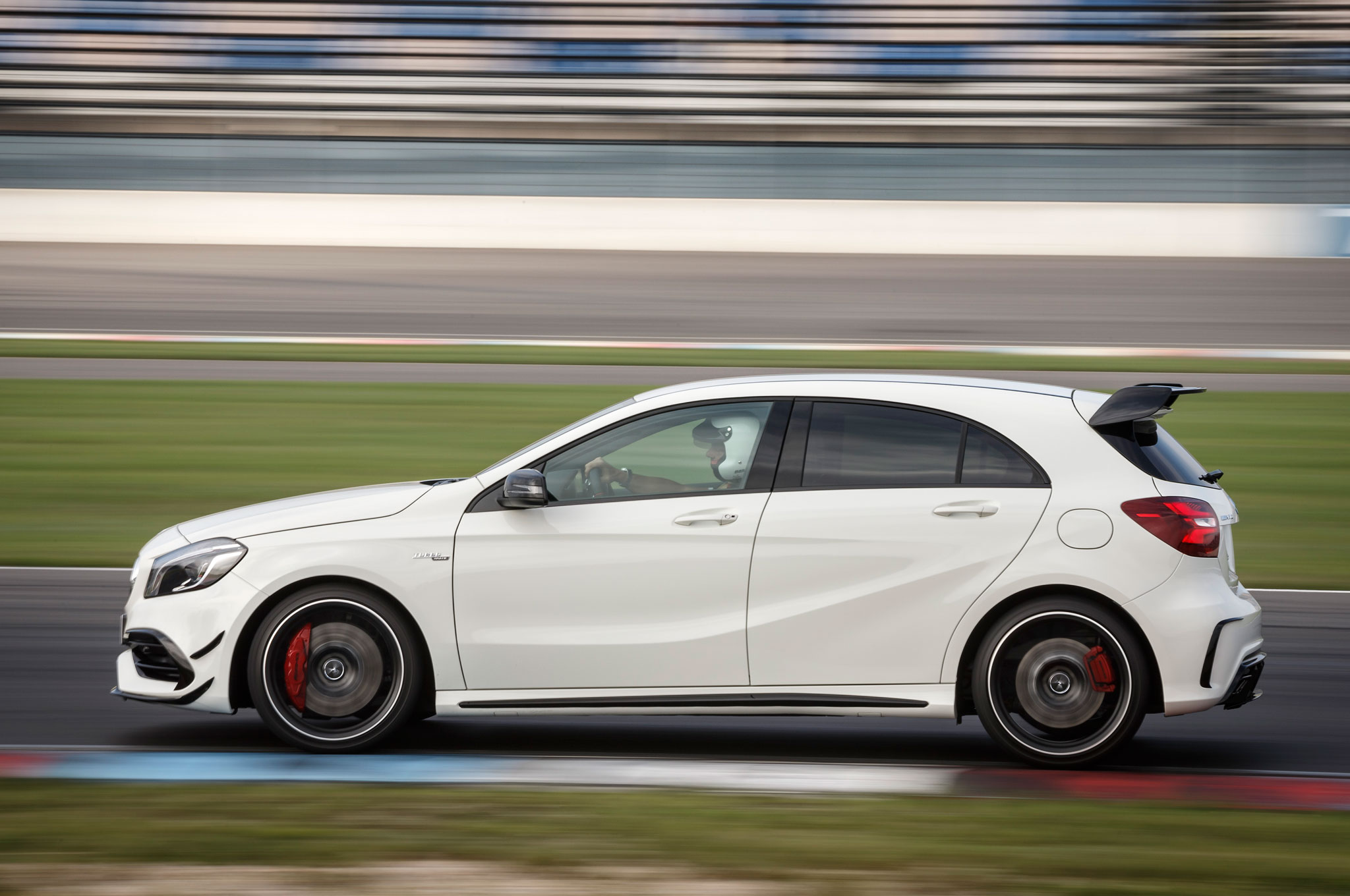 http://st.automobilemag.com/uploads/sites/11/2015/09/2016-Mercedes-AMG-A45-4Matic-side-profile-in-motion-02.jpg