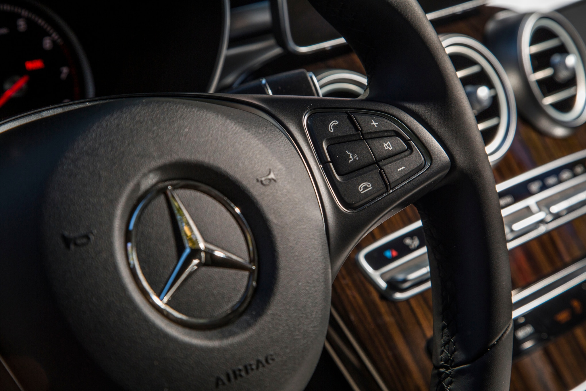 2016 mercedes benz glc300 review for Mercedes benz steering wheel control buttons