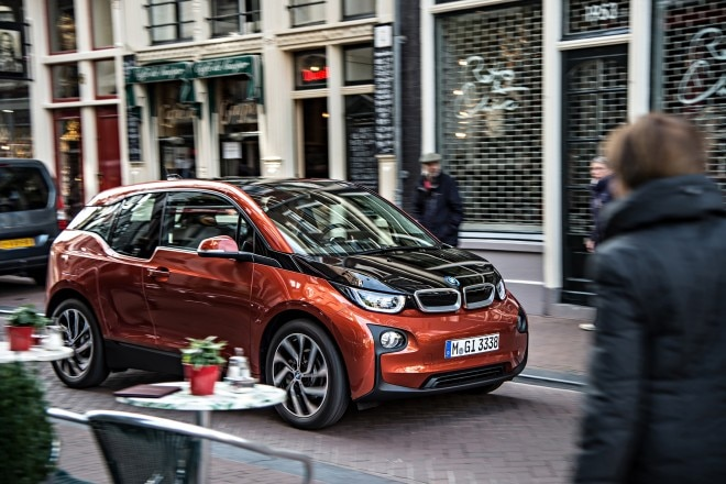 2014 BMW i3 eDrive three quarters view in motion city