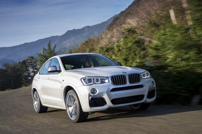 2016 BMW X4 M40i front three quarter in motion 15 1