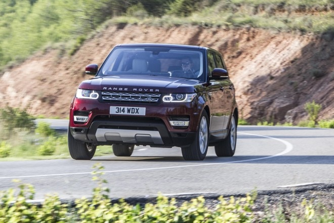 2016 Land Rover Range Rover Sport Td6 front three quarter in motion 20
