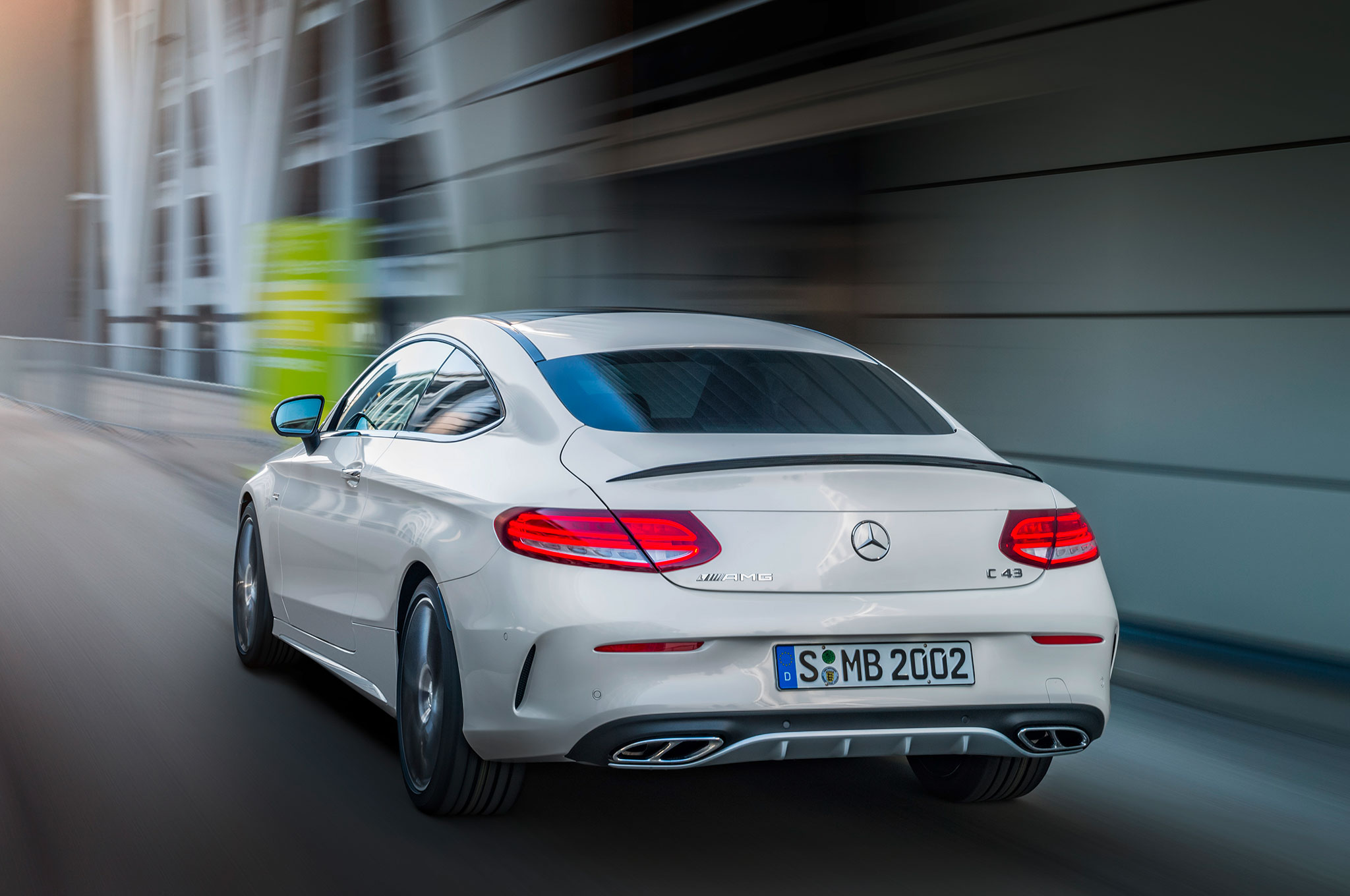 http://st.automobilemag.com/uploads/sites/11/2016/02/2017-Mercedes-AMG-C43-Coupe-rear-three-quarter-in-motion-02.jpg