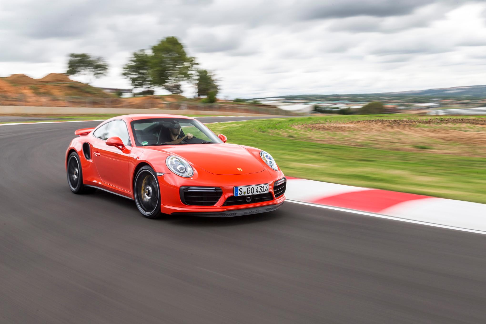 2017 Porsche 911 Turbo S front three quarter in motion 02