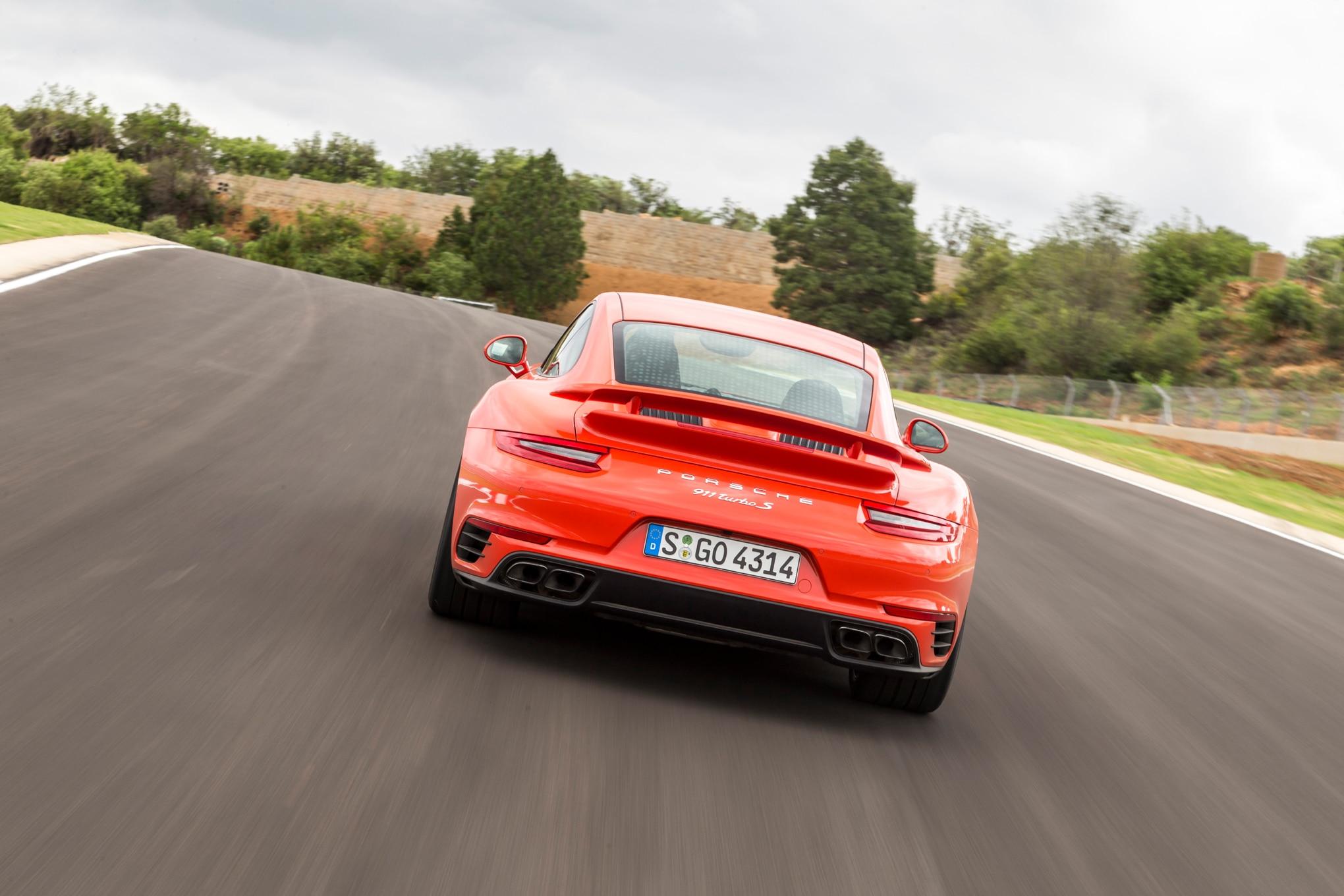 2017 Porsche 911 Turbo S rear end in motion 02